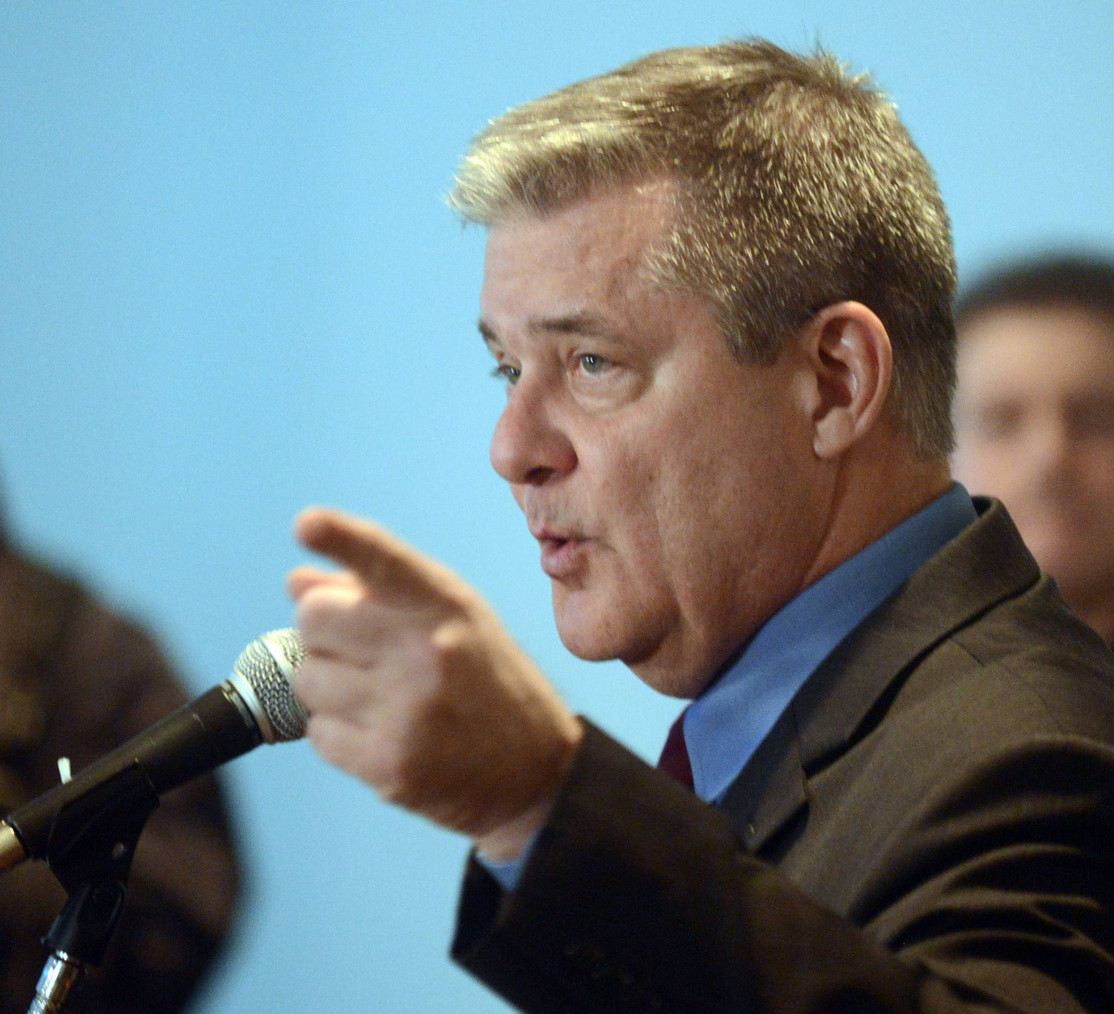 Illinois State Treasurer Dan Rutherford denies accusations against him during a news conference Monday in Schaumburg.