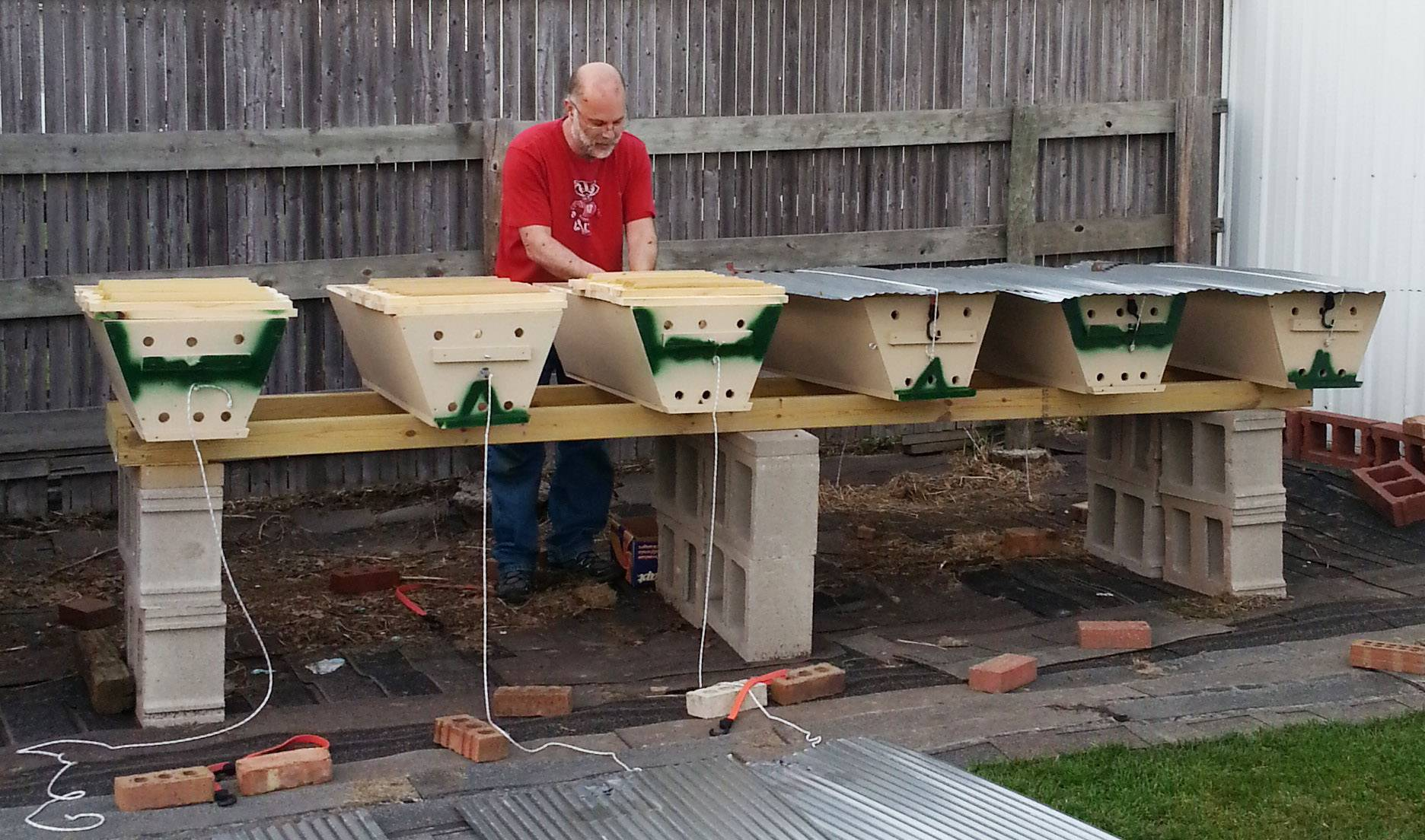 David Bergman prepares top bar hives in Wadsworth last spring.