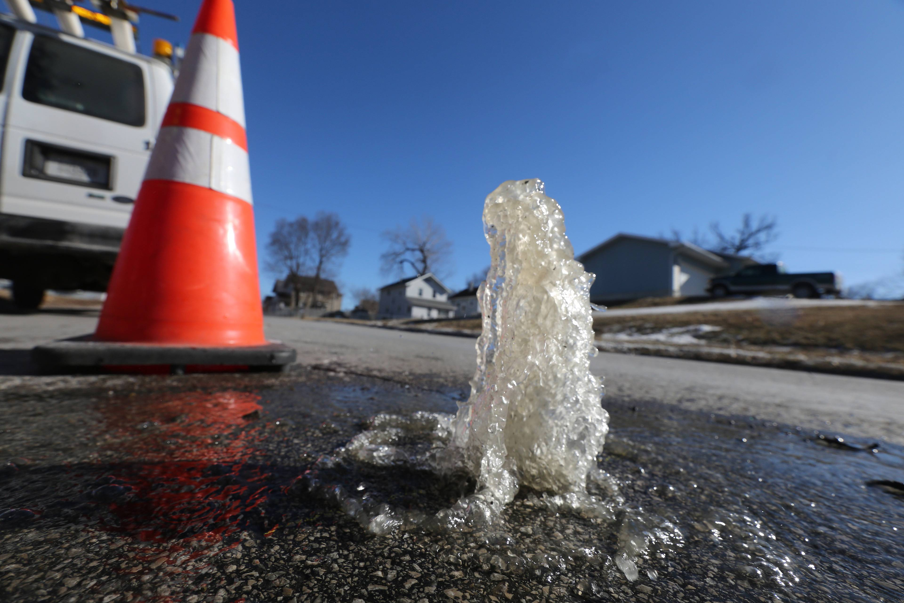 A broken water main spurts from a pilot hole dug to find the break in Des Moines. A Des Moines official said the city has never endured so many broken water mains in the 100-year history of its water utility.