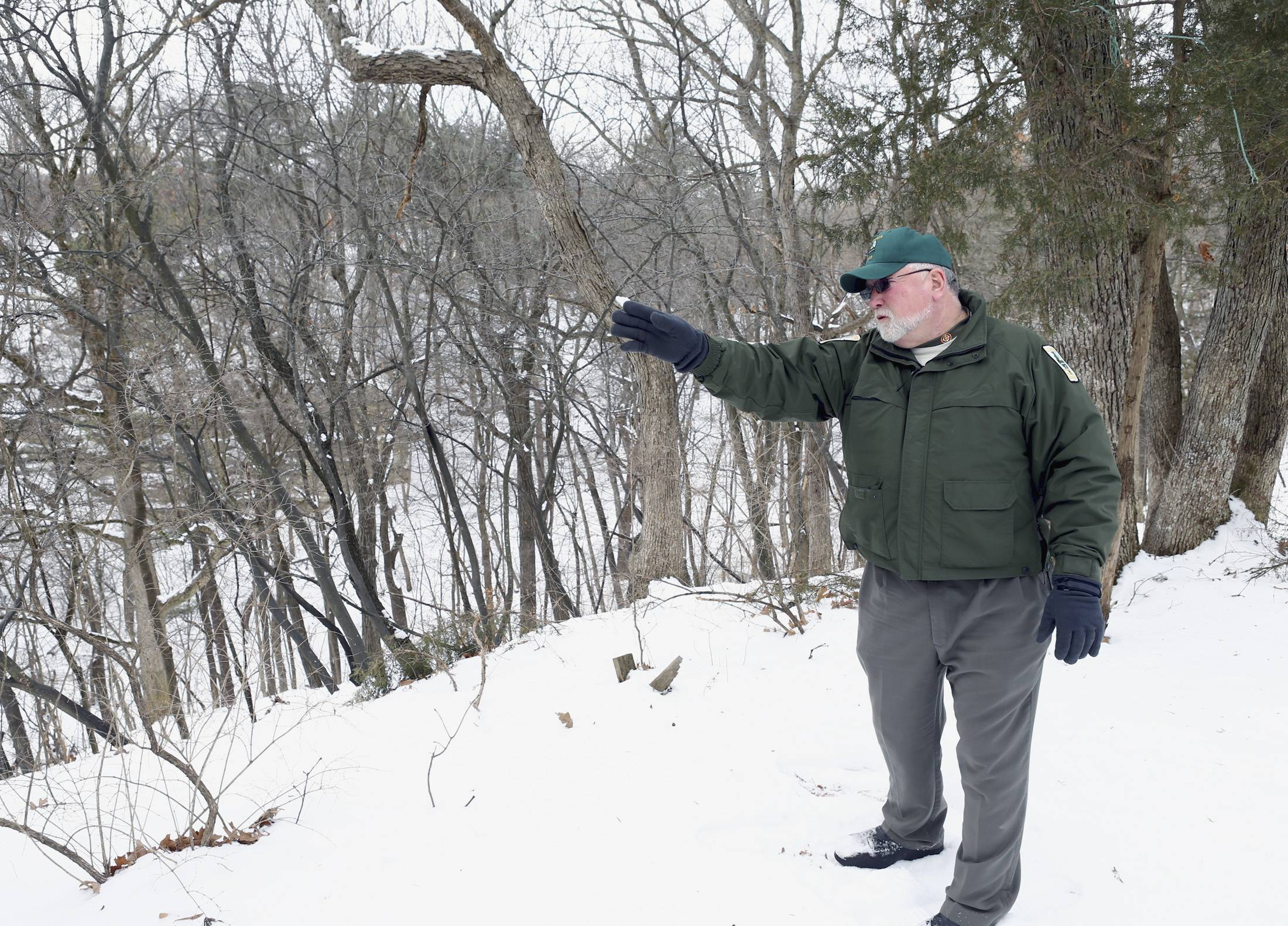Starved Rock State Park site superintendent Mark McConnaughhay points to Curtis Canyon, part of White Oak Campground property south of Utica.