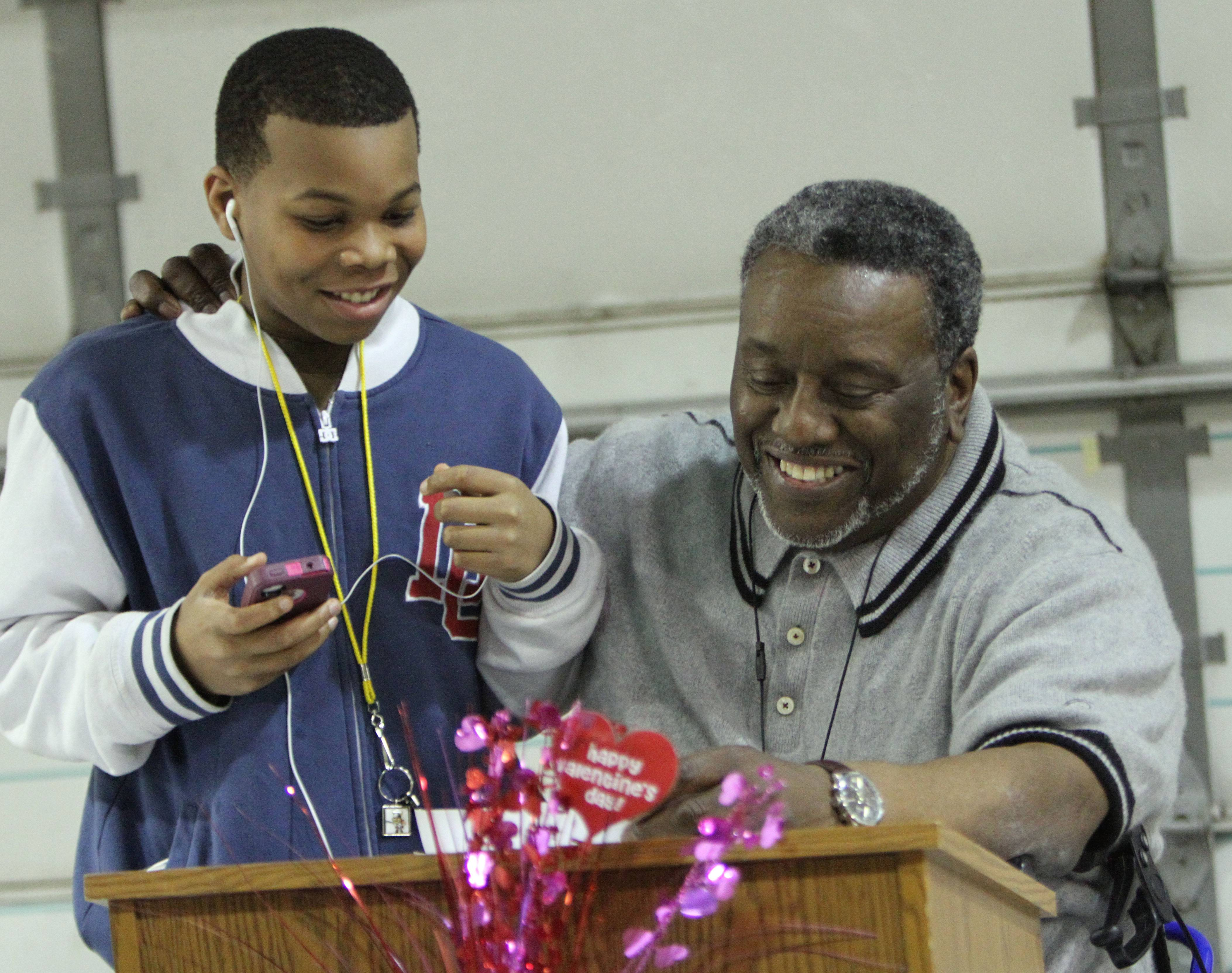 Milton Whitington, 63, of Waukegan thanks the people responsible for his new car. The refurbished Dodge Neon was presented to Whittington Wednesday through a program called Recycled Ride sponsored by Carstar in Mundelein and Esurance. Whittington's 13-year-old grandson Jaden Whittington, left, lives with him.