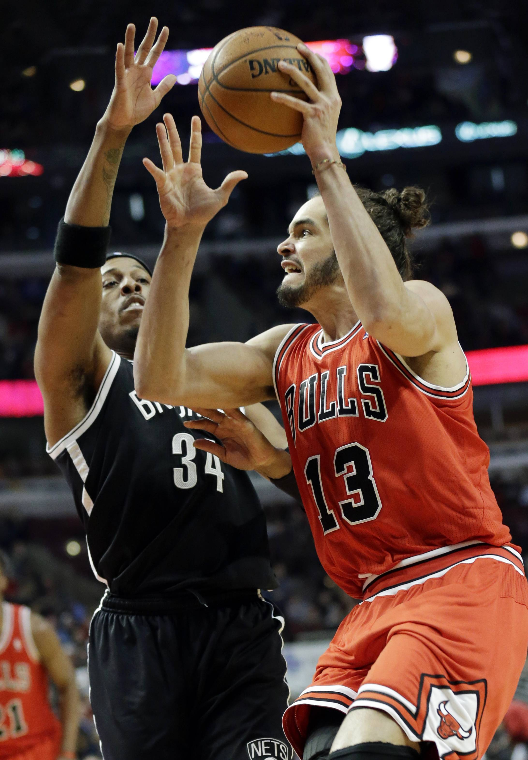 Bulls center Joakim Noah, the team's only all-star, shoots against the Nets' Paul Pierce during the second half Thursday night at the United Center. The Bulls go into the all-star break at 27-25.