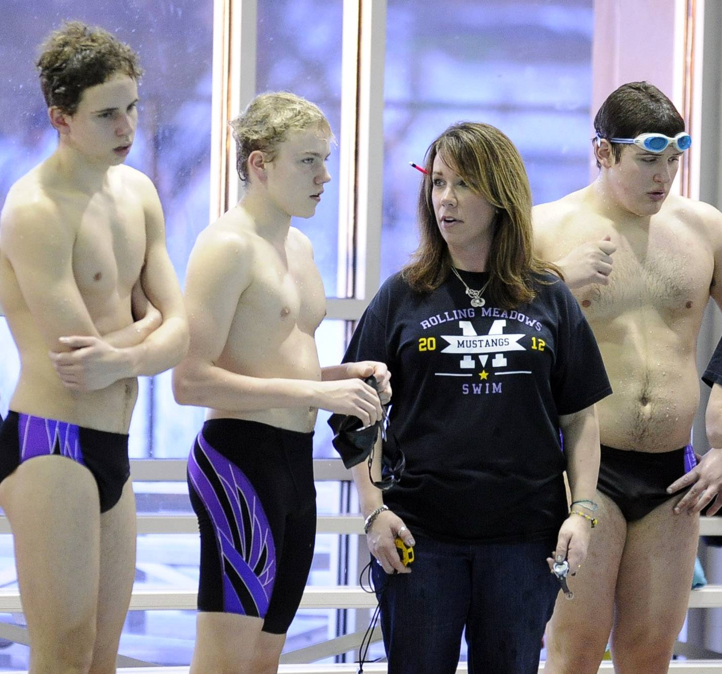 Rolling Meadows coach Monika Chiapetta chats with freshman Filip Pancerz, left, during a recent meet at Olympic Pool in Arlington Heights. The Mustangs' improvement is one reason this year's MSL meet figures to be one of the best ever.