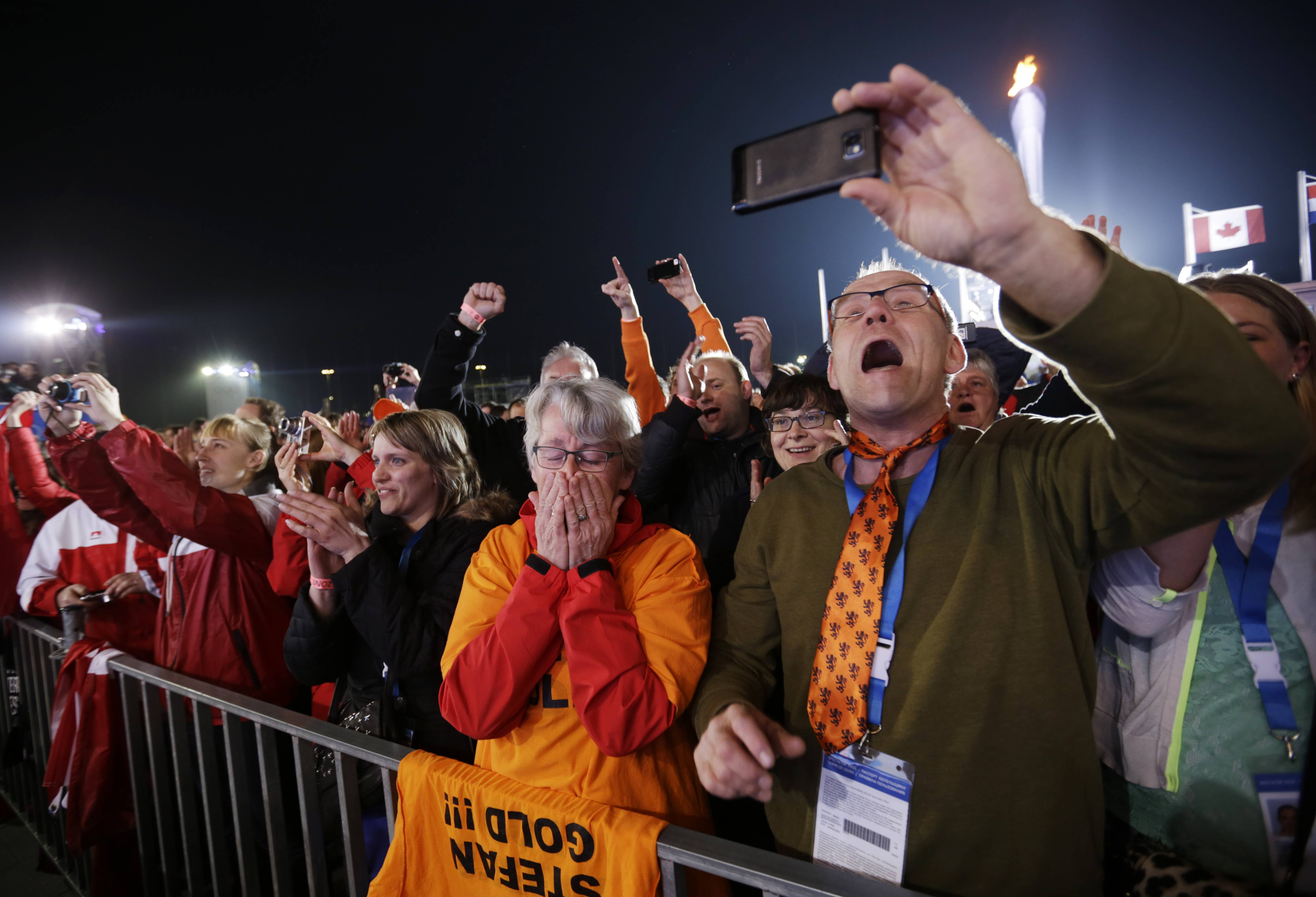 Aart Groothuis and his wife Hendrika Tekelenburg watch their son Stefan Groothuis, of the Netherlands, receive his gold medal in the men's 1000-meter speedskating .