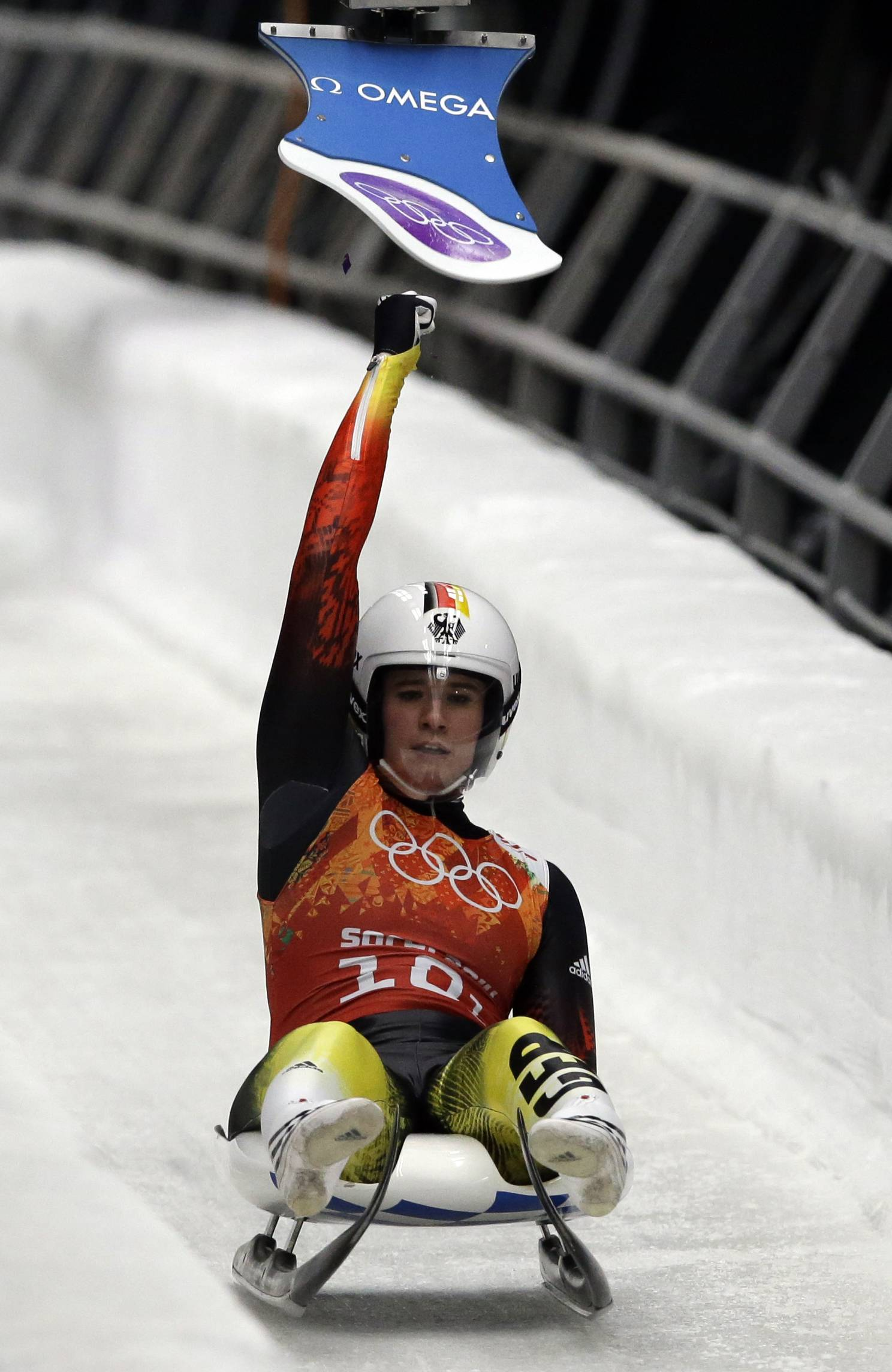 Germany's Natalie Geisenberger hits the relay pad so teammate Felix Loch can start his run during the luge team relay competition. The German team won the gold medal. (AP Photo/Dita Alangkara)