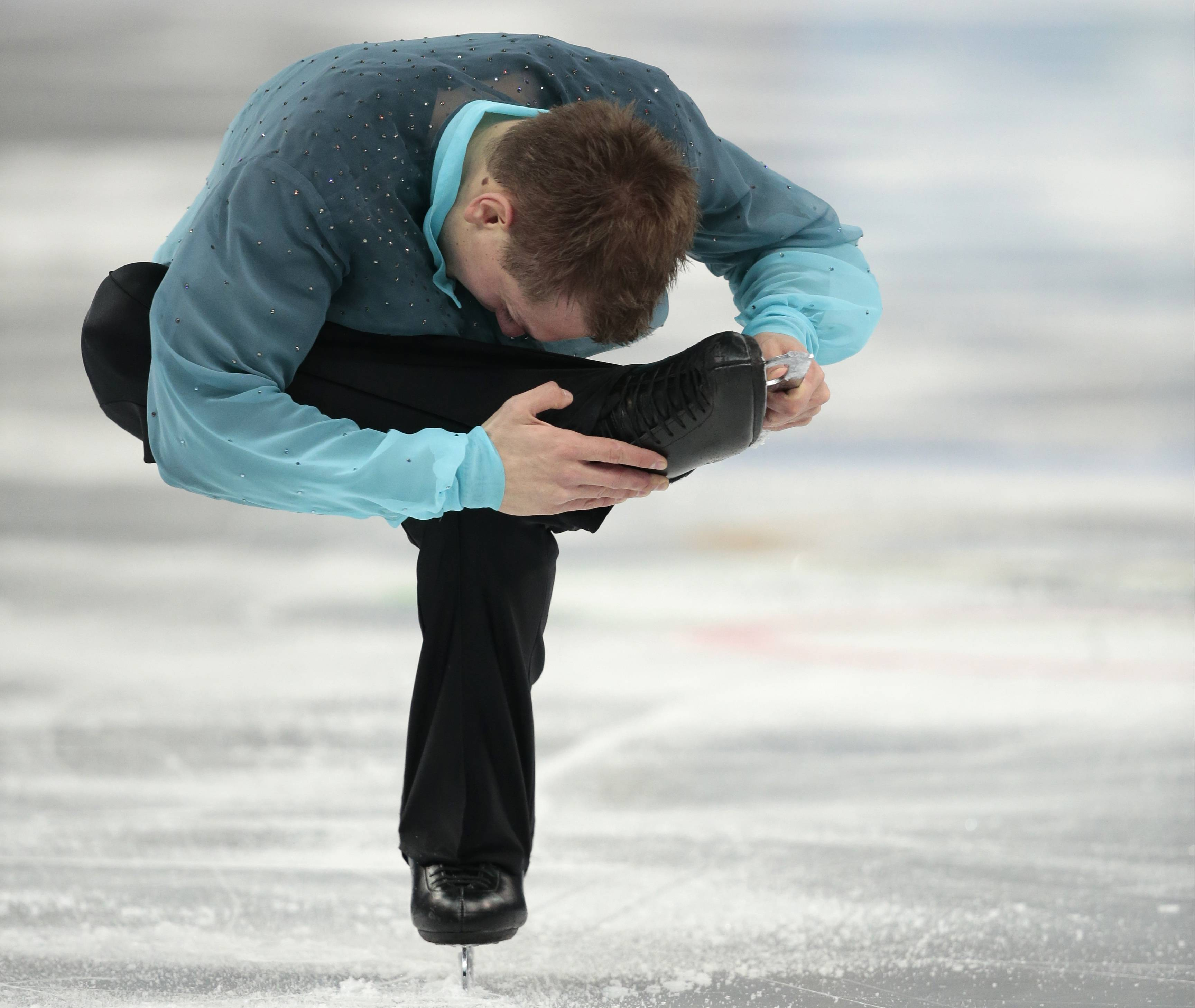 Peter Liebers of Germany competes in the men's short program figure skating competition.