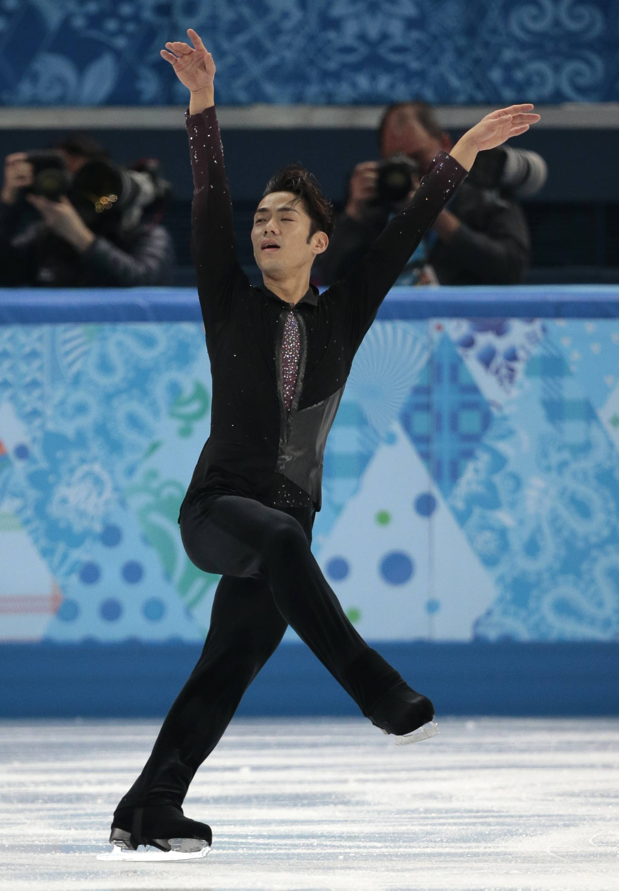 Daisuke Takahashi of Japan competes in the men's short program figure skating competition.