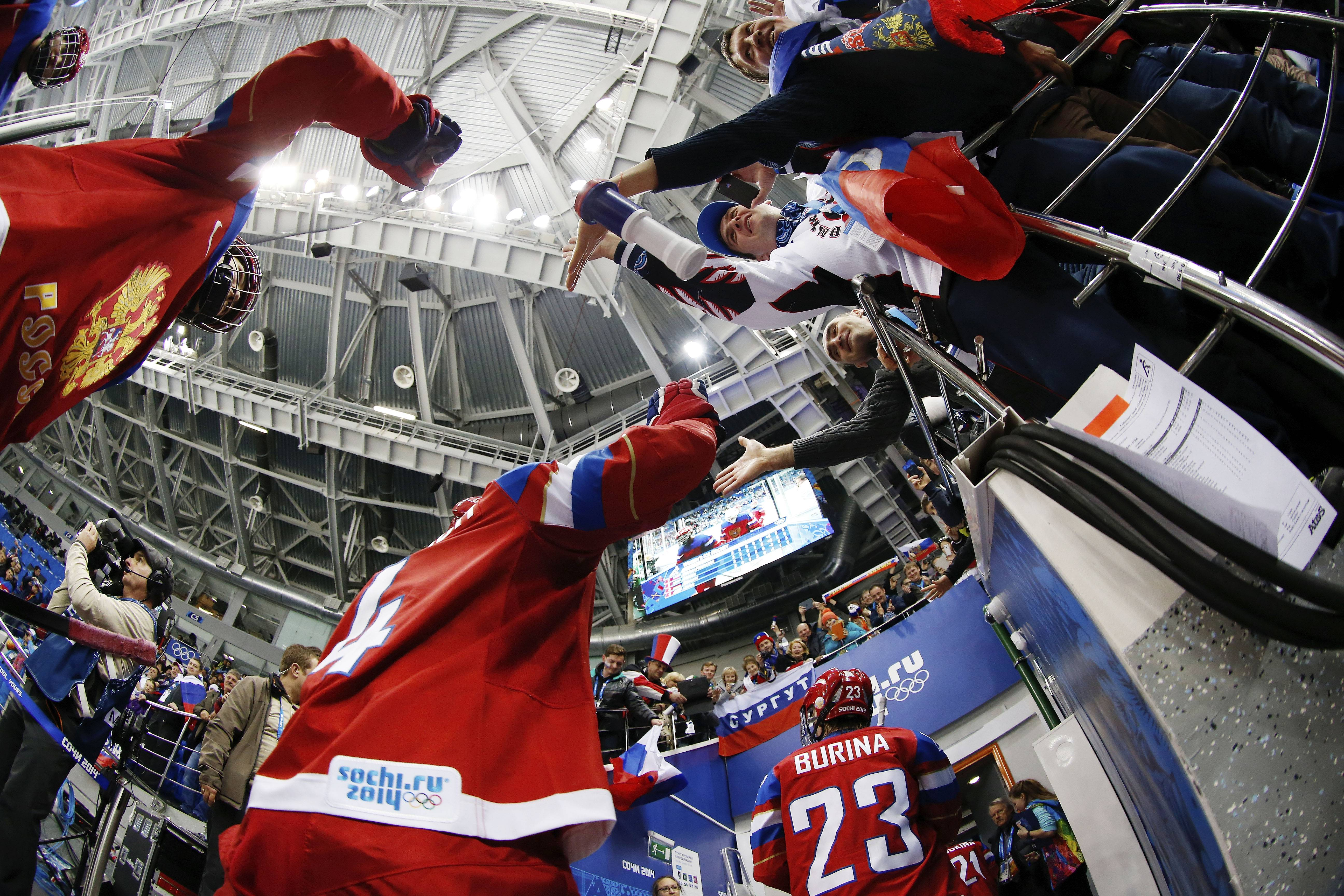 Team Russia leaves the ice after defeating Sweden 3-1 during the 2014 Winter Olympics women's ice hockey game.