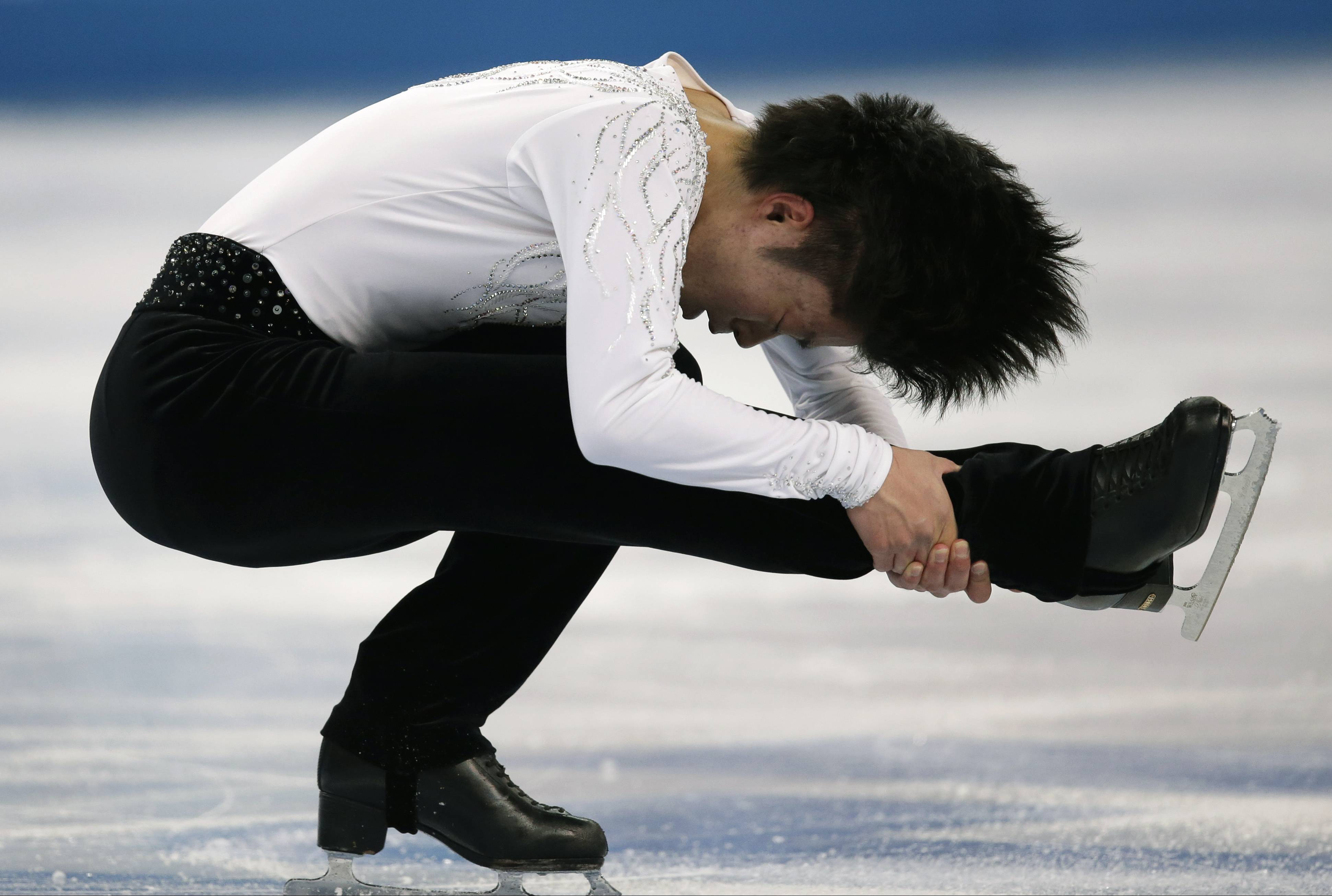 Tatsuki Machida of Japan competes in the men's short program figure skating competition.