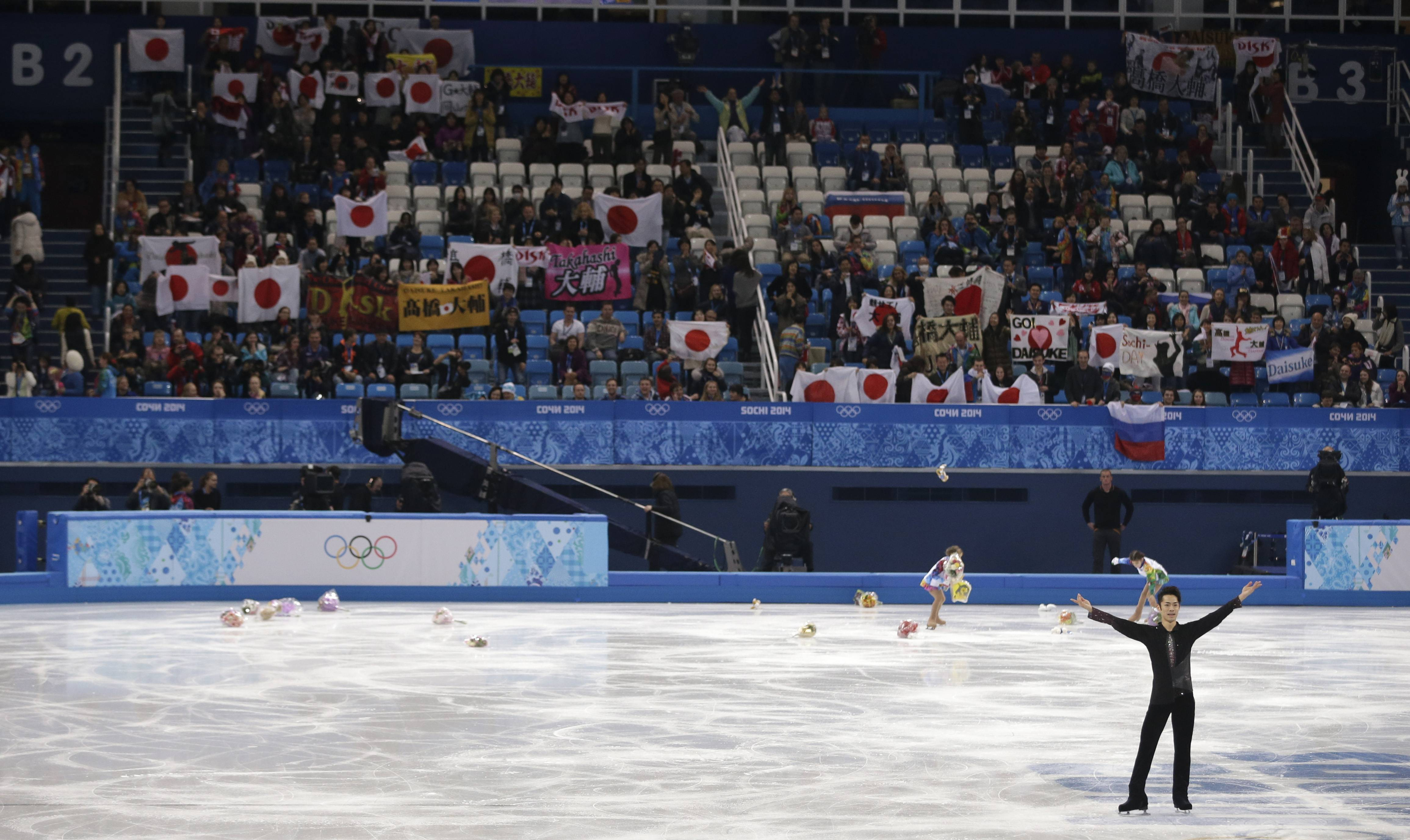 Daisuke Takahashi of Japan acknowledges the crowd after competing in the men's short program figure skating competition.