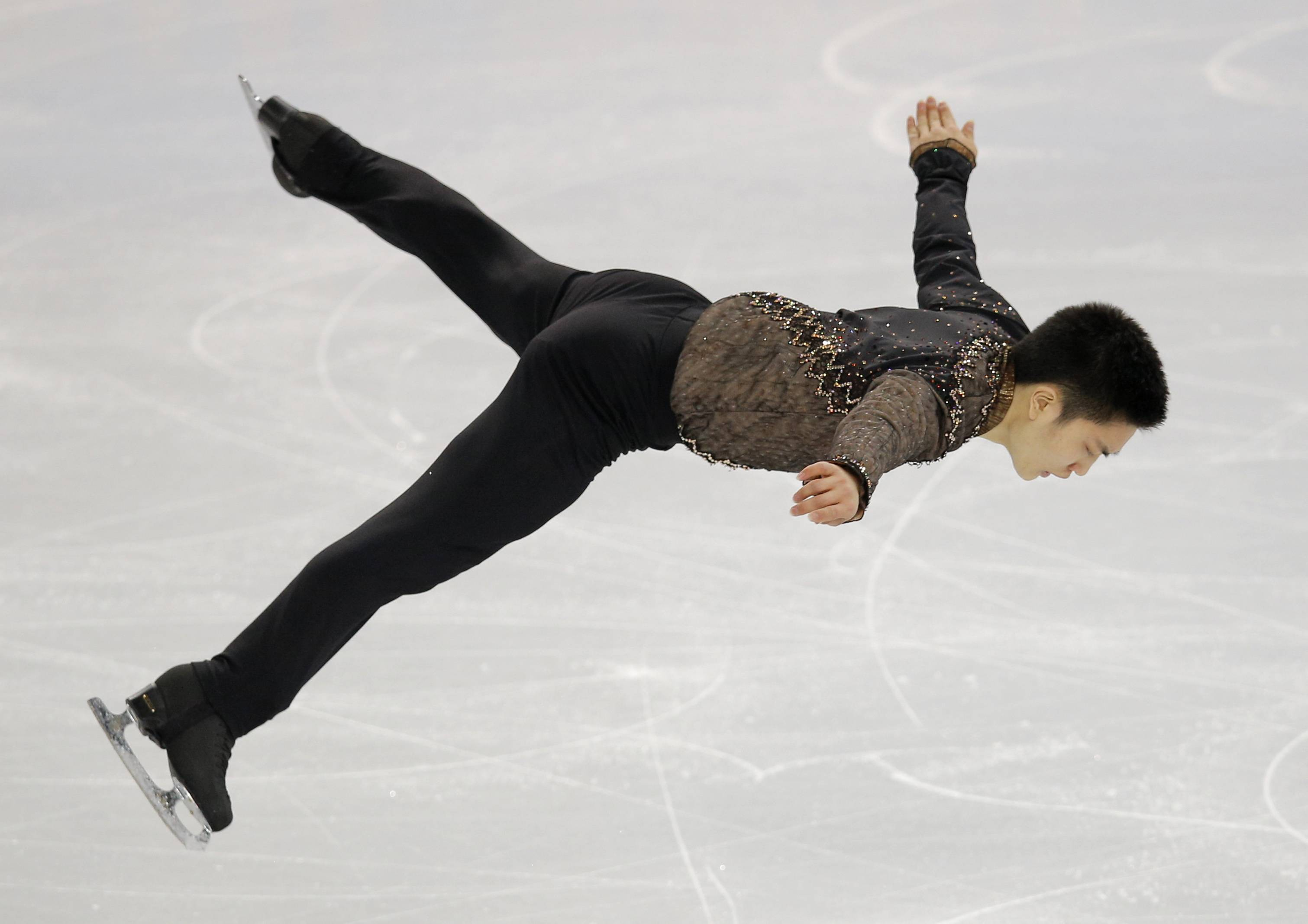 Denis Ten of Kazakhstan competes in the men's short program figure skating competition.