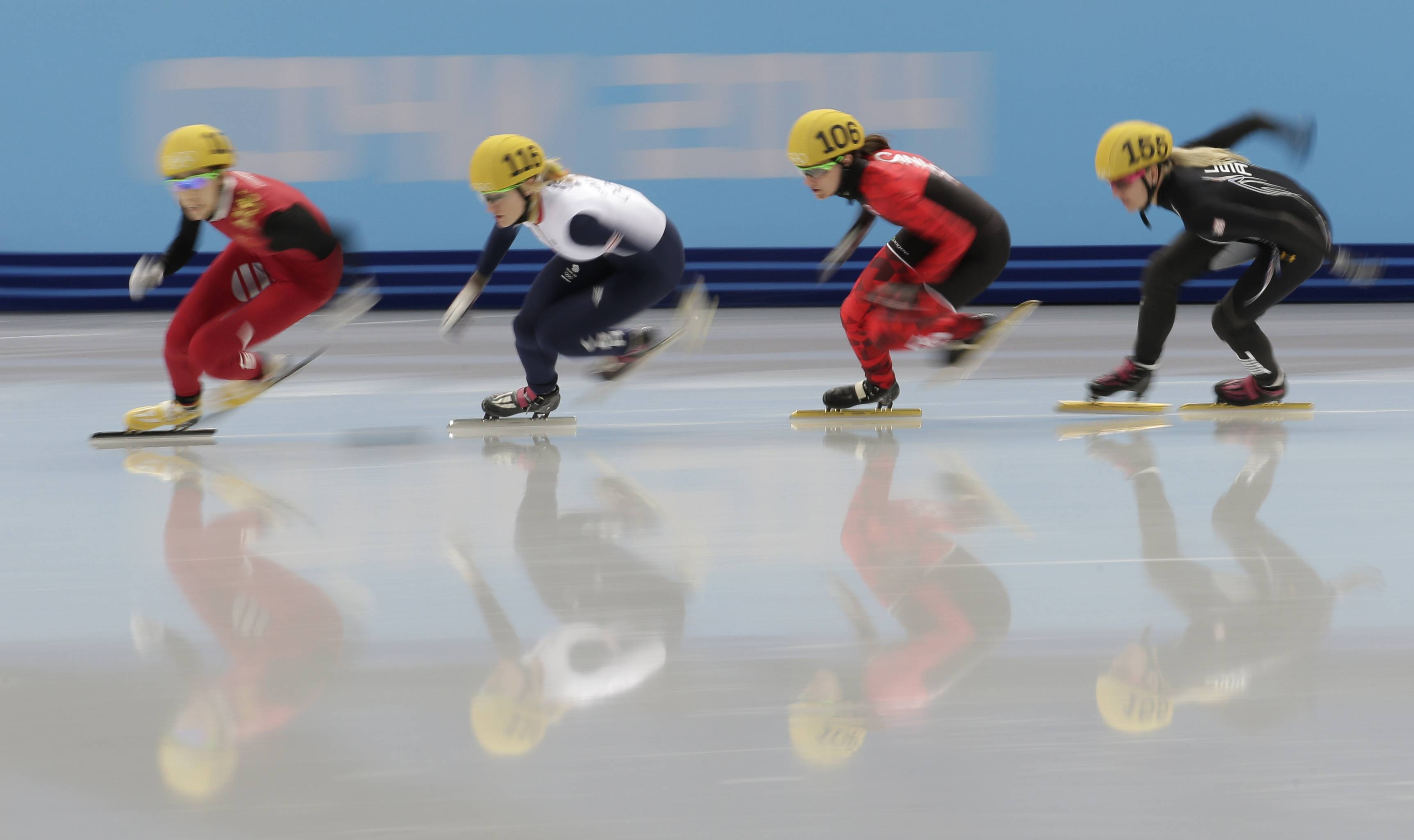 From left, Fan Kexin of China, Elise Christie of Britain, Jessica Hewitt of Canada and Emily Scott of the United States compete in a women's 500m short track speedskating quarterfinal.