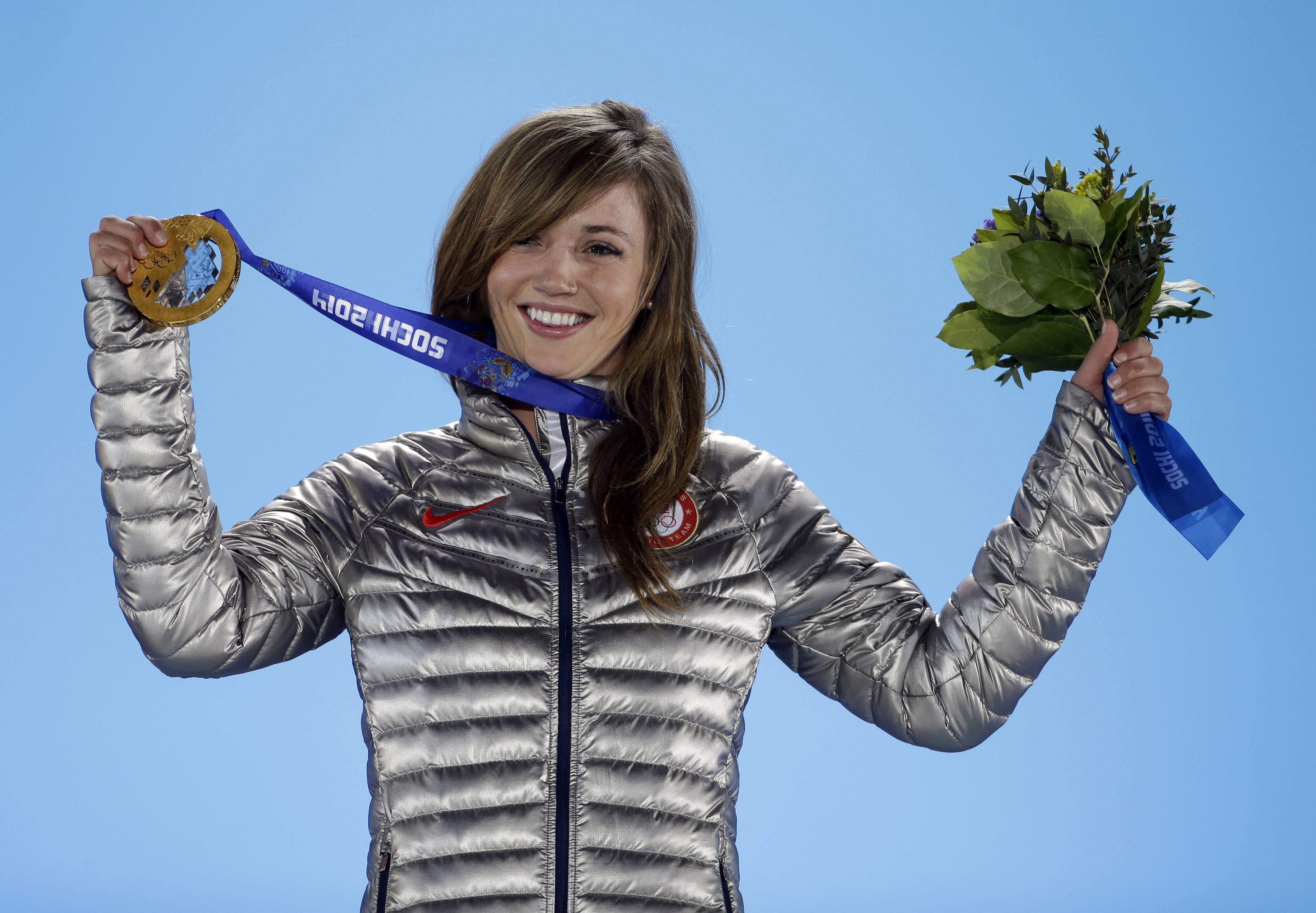 Women's snowboard halfpipe gold medalist Kaitlyn Farrington of the United States smiles during the medals ceremony.
