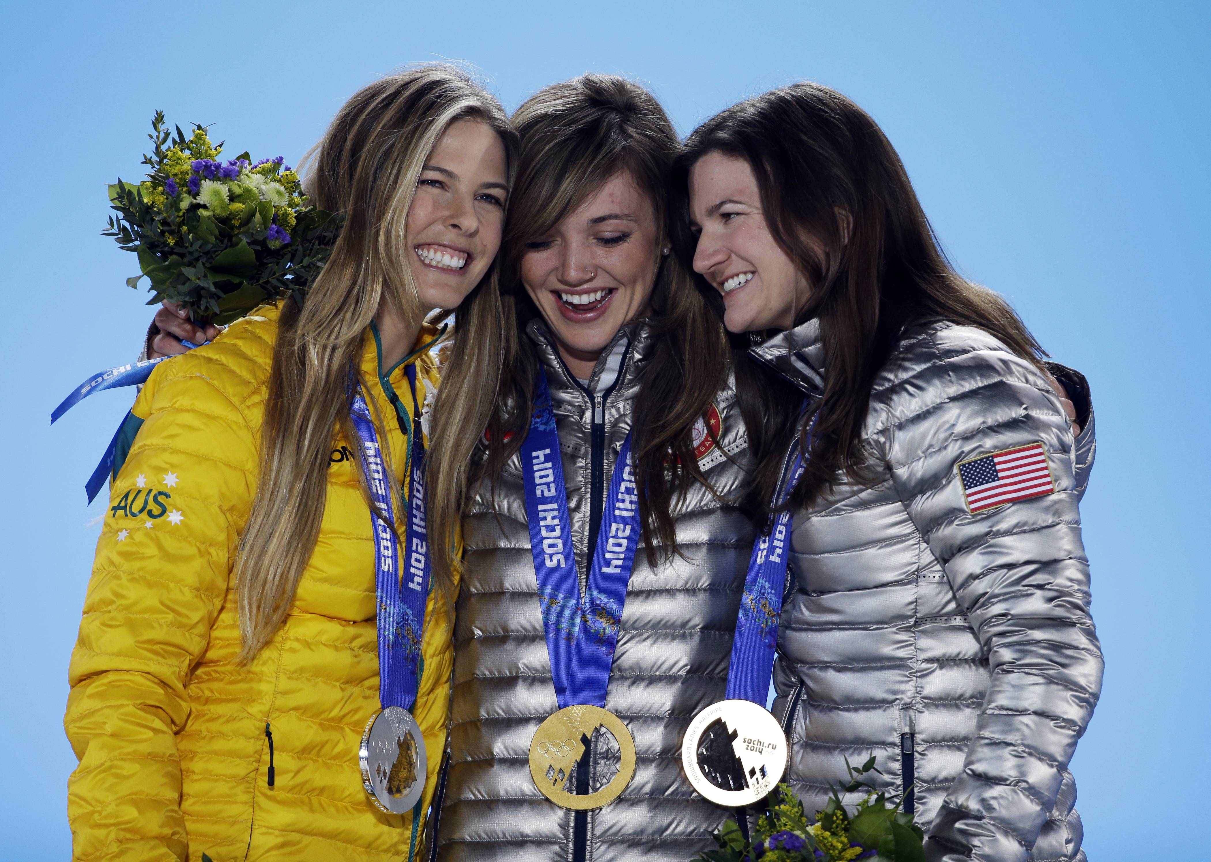 Women's snowboard halfpipe medalists, from left, Torah Bright of Australia, silver, Kaitlyn Farrington of the United States, gold, and Kelly Clark of the United States, bronze, pose with their medals.