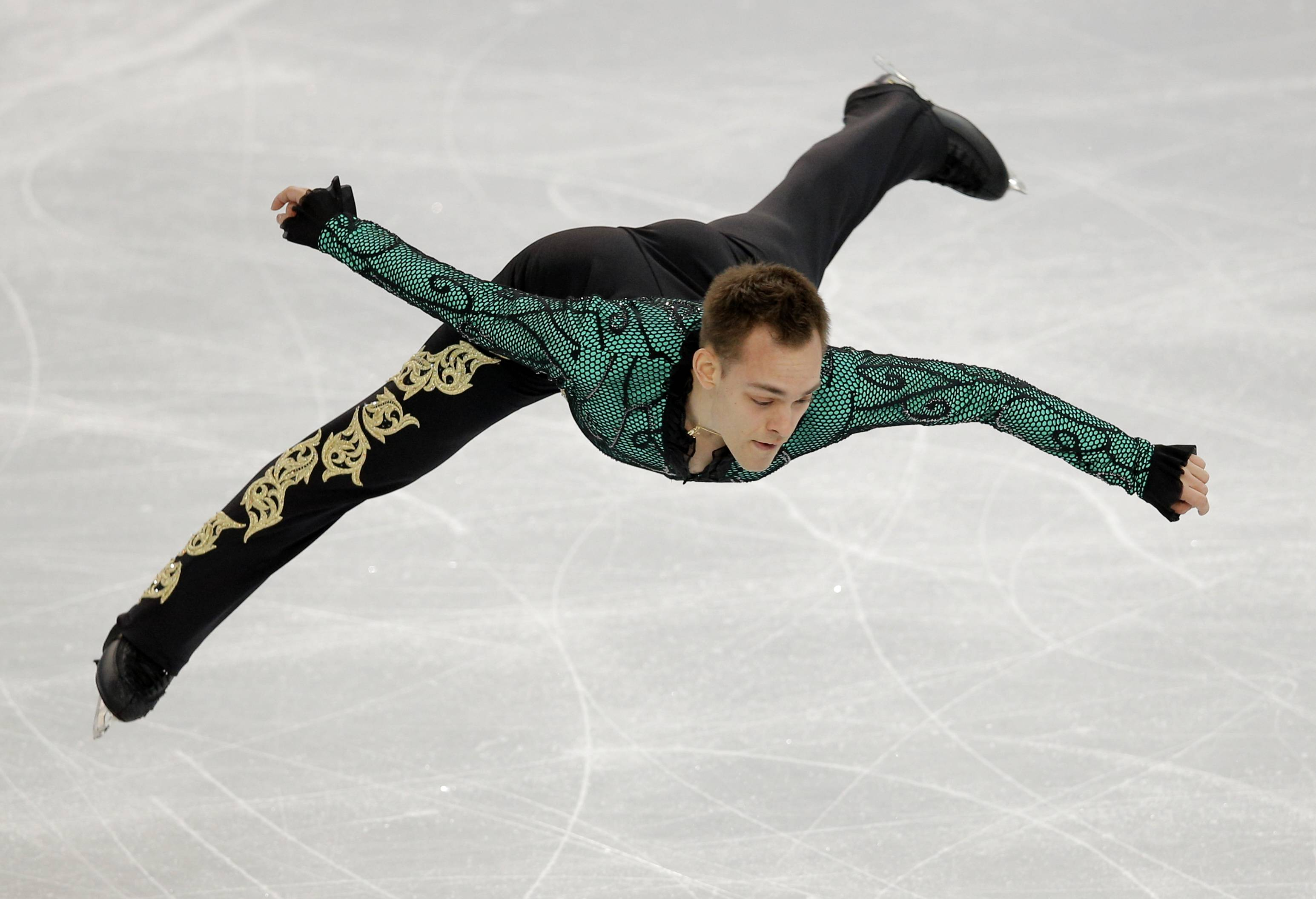 Paul Bonifacio Parkinson of Italy competes in the men's short program figure skating competition.