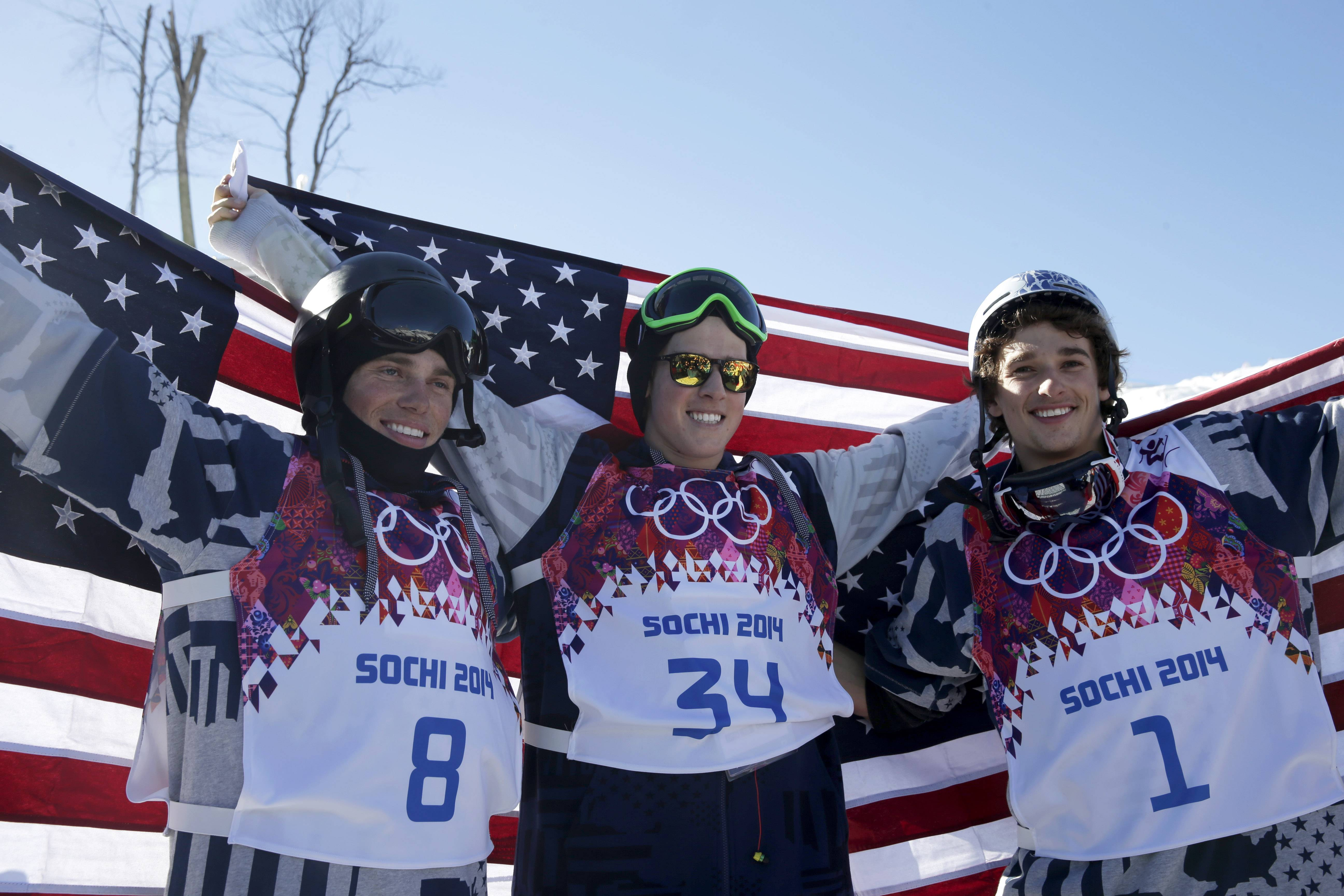 Men's freestyle ski slopestyle medalists from the United States Gus Kenworthy, left, silver, Joss Christensen, center, gold, and Nicholas Goepper, bronze, right, pose for photographers Thursday at the Rosa Khutor Extreme Park at the 2014 Winter Olympics in Krasnaya Polyana, Russia.