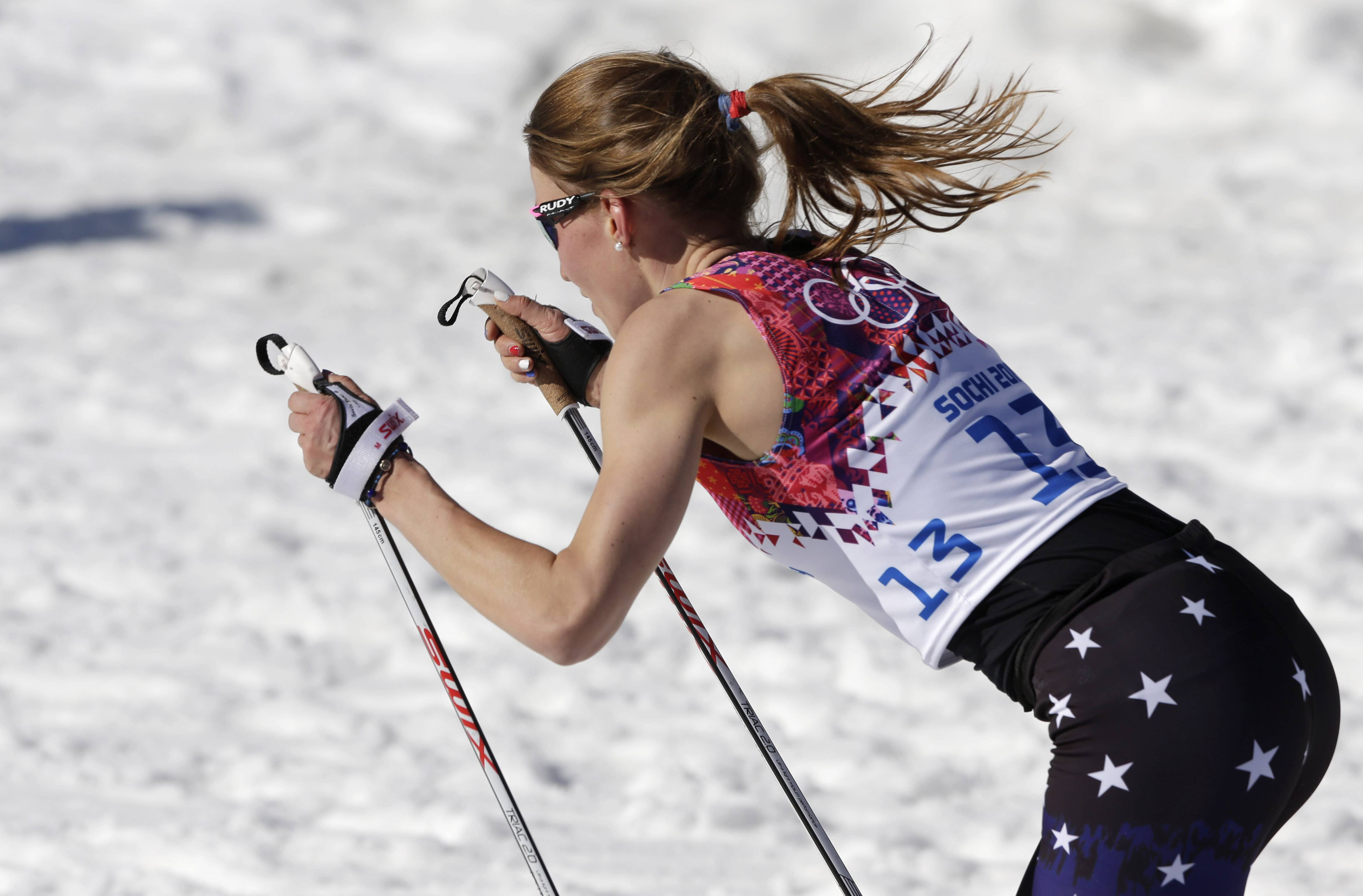 United States cross country skier Sophie Caldwell skis with a sleeveless top Thursday during the women's 10K classical-style race at the 2014 Winter Olympics in Krasnaya Polyana, Russia.