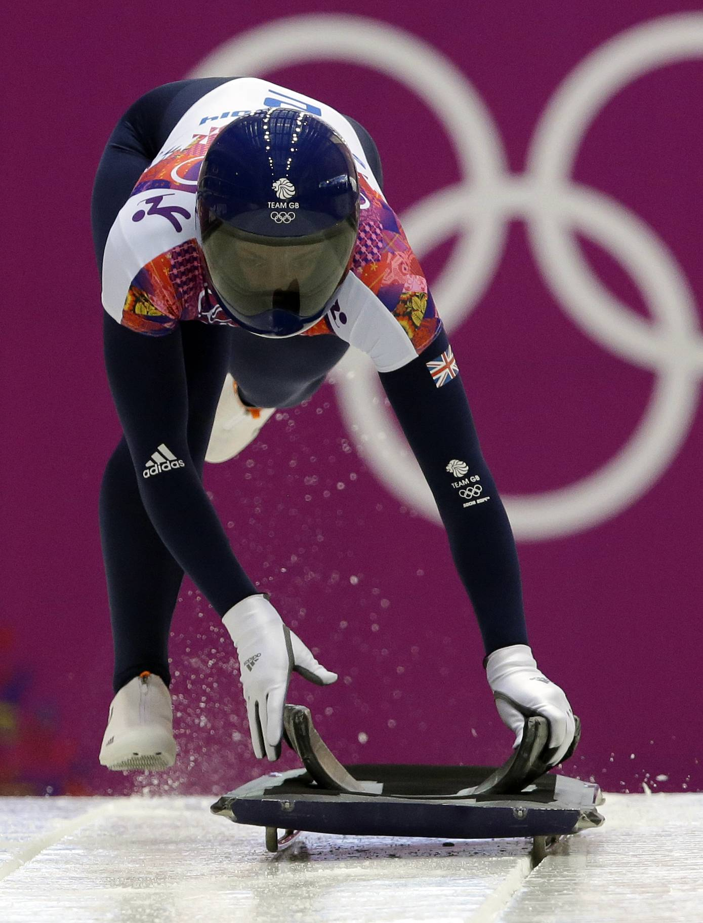 Elizabeth Yarnold starts her first run Thursday during the women's skeleton competition at the 2014 Winter Olympics in Krasnaya Polyana, Russia.