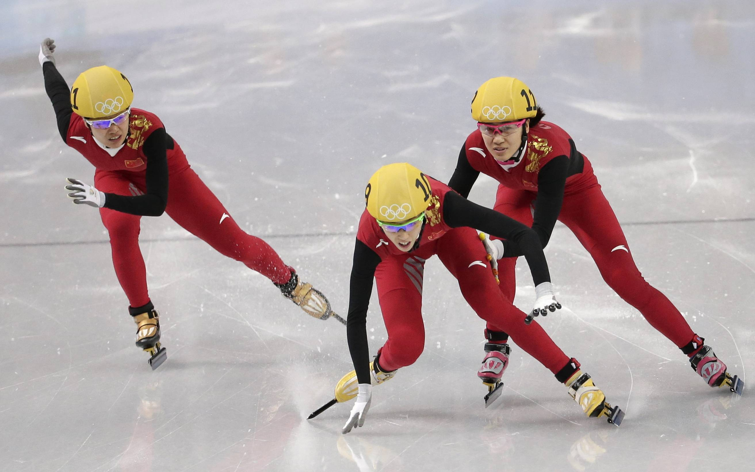 Fan Kexin of China, center, loses her balance as Liu Qiuhong of China, right, and Li Jianrou of China compete Thursday in a women's 500m short track speedskating semifinal at the Iceberg Skating Palace during the 2014 Winter Olympics in Sochi, Russia.