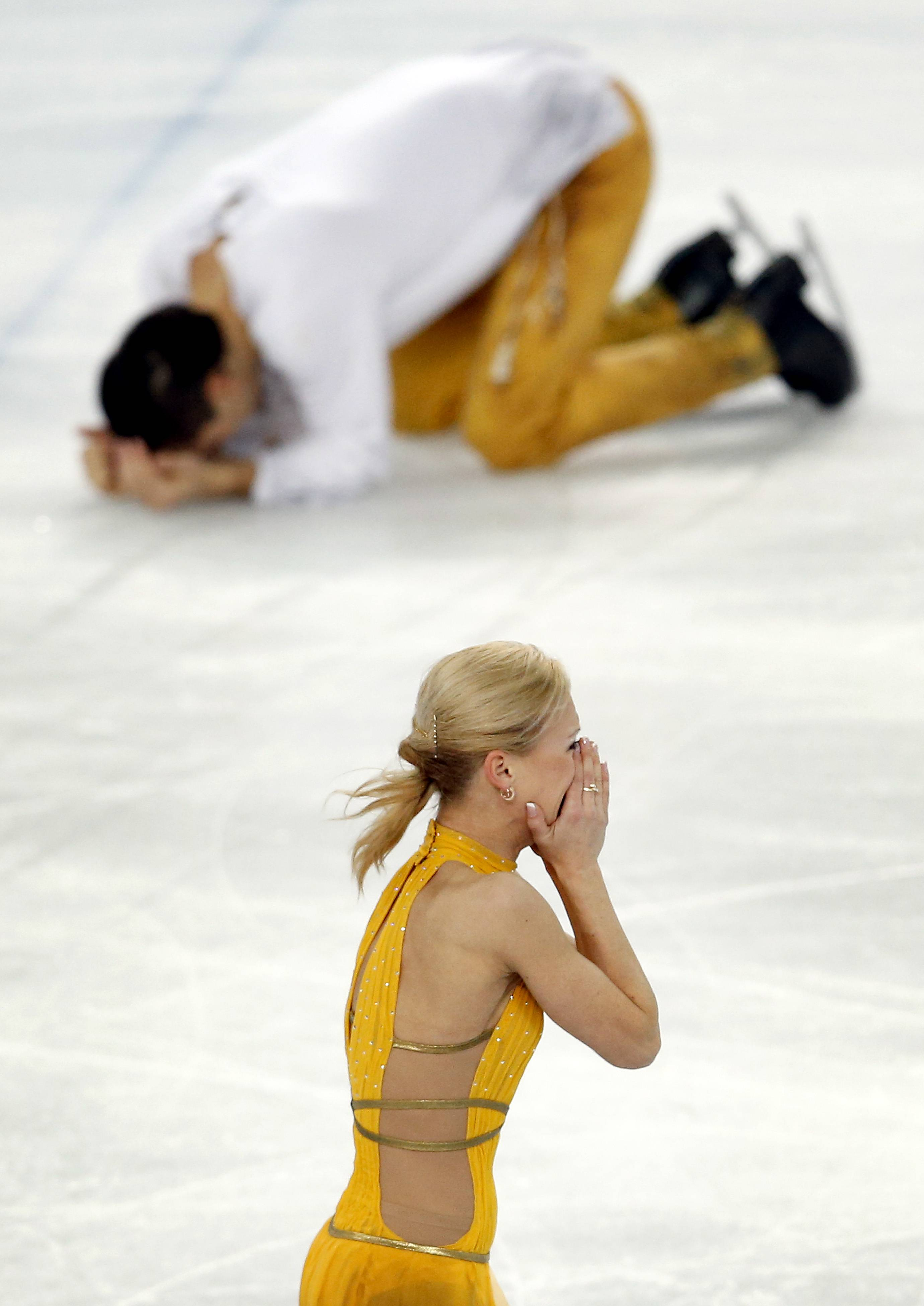 Russia's Tatiana Volosozhar, bottom, and Maxim Trankov react after finishing their routine in the pairs free skate figure skating competition at the Winter Olympics, Wednesday, Feb. 12, 2014, in Sochi, Russia. (AP Photo/Star Tribune, Carlos Gonzalez) ST. PAUL PIONEER PRESS OUT; SOFT OUT MINNEAPOLIS-AREA TV NOT TV; MAGAZINES OUT