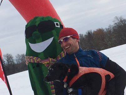Brad Zoller of Palatine, pictured here with his dog, was the winner of the Smart Farm of Barrington's 2014 Frozen Zucchini Snowshow event.