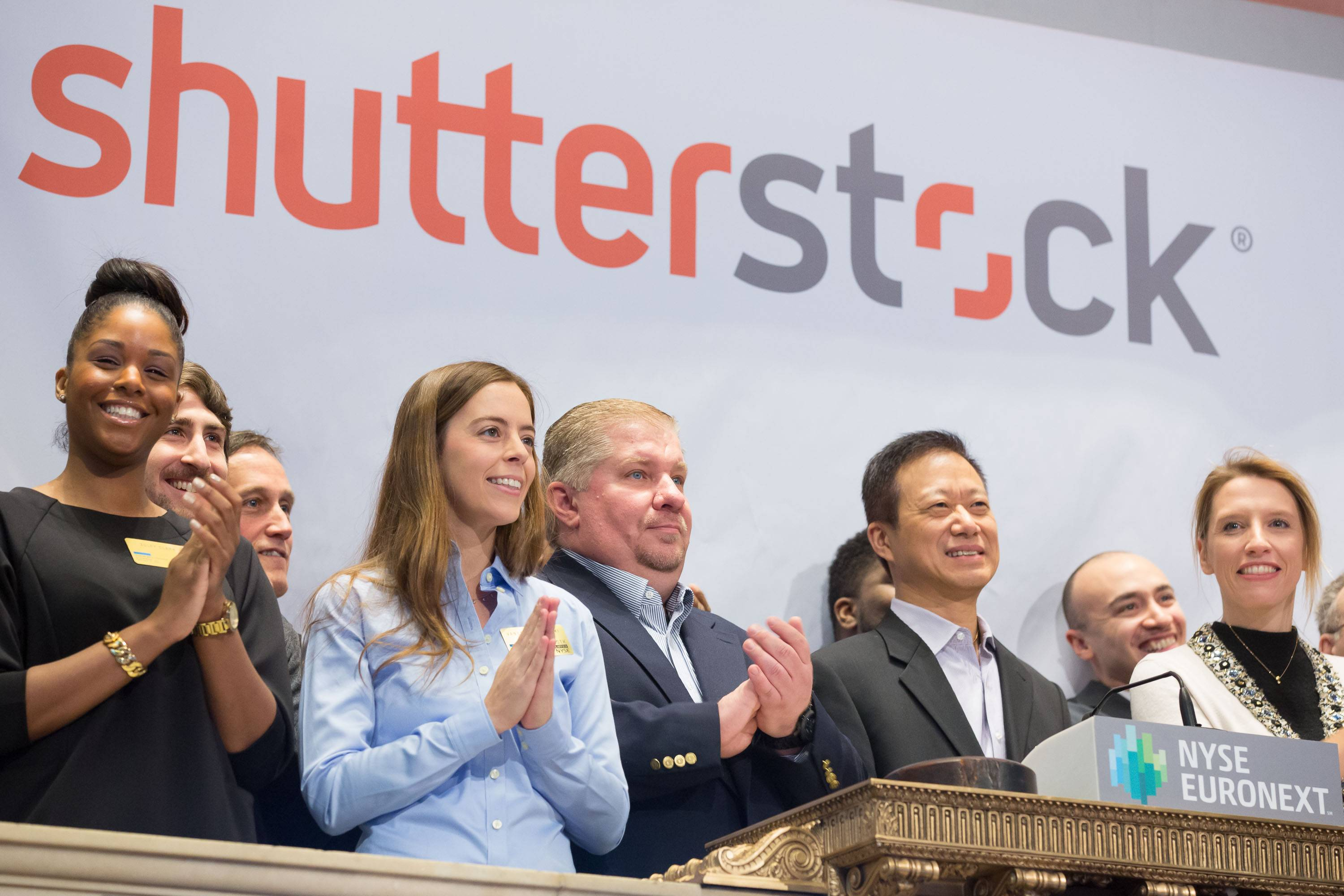 Shutterstock's Chief Technology Officer, James Chou, joined by members of the company's leadership team and Fast Company's Associate Editor, J.J. McCorvey rings the opening bell at The New York Stock Exchange in New York City.