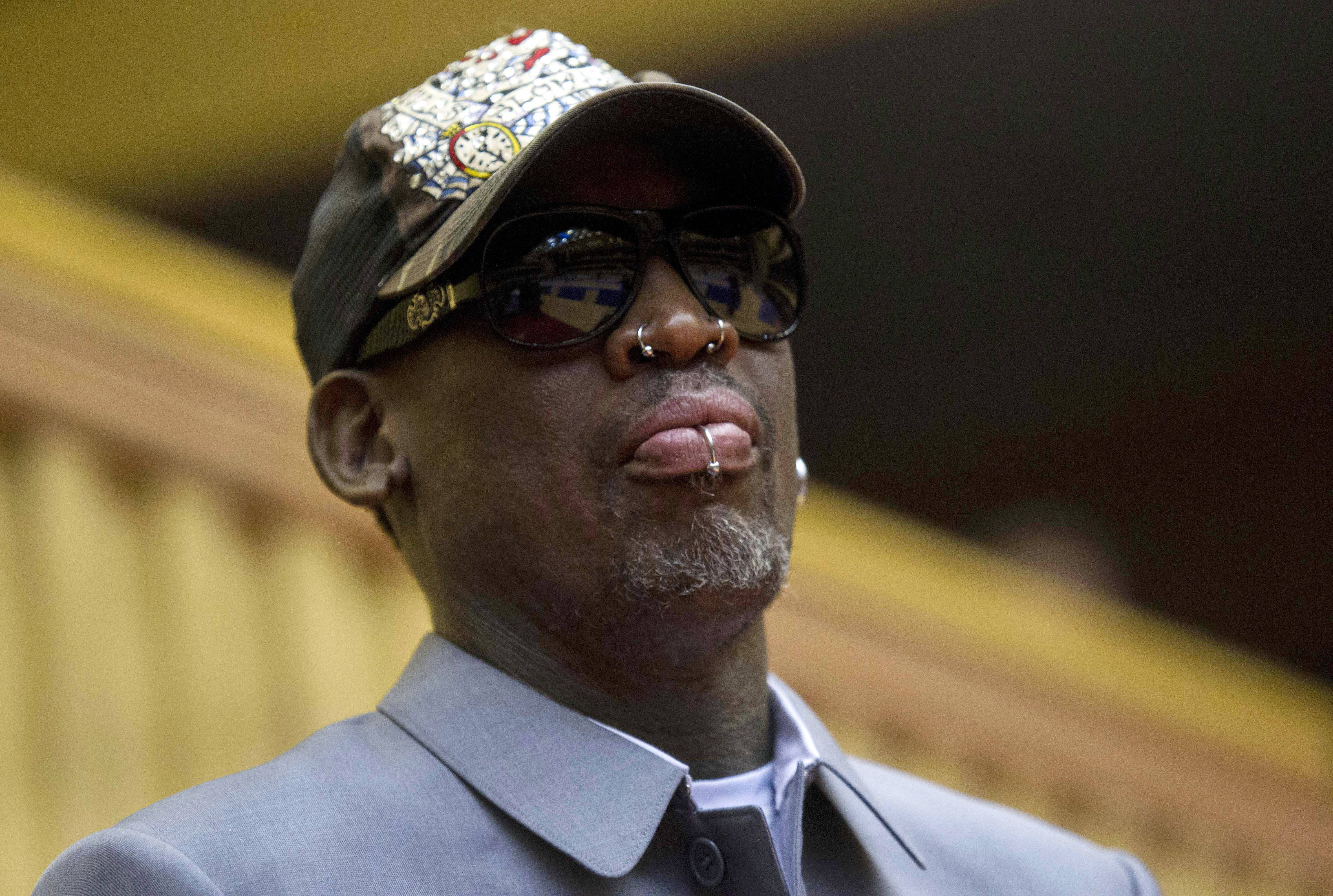 FILE - In this Jan. 8, 2014, file photo, former NBA basketball player Dennis Rodman looks out at the court at the end of an exhibition basketball game with U.S. and North Korean players at an indoor stadium in Pyongyang, North Korea. Rodman checked into an alcohol-rehabilitation center to reevaluate his life, not give up drinking. He spent three weeks in a New Jersey-based facility when he returned from his latest trip to North Korea.(AP Photo/Kim Kwang Hyon, File)