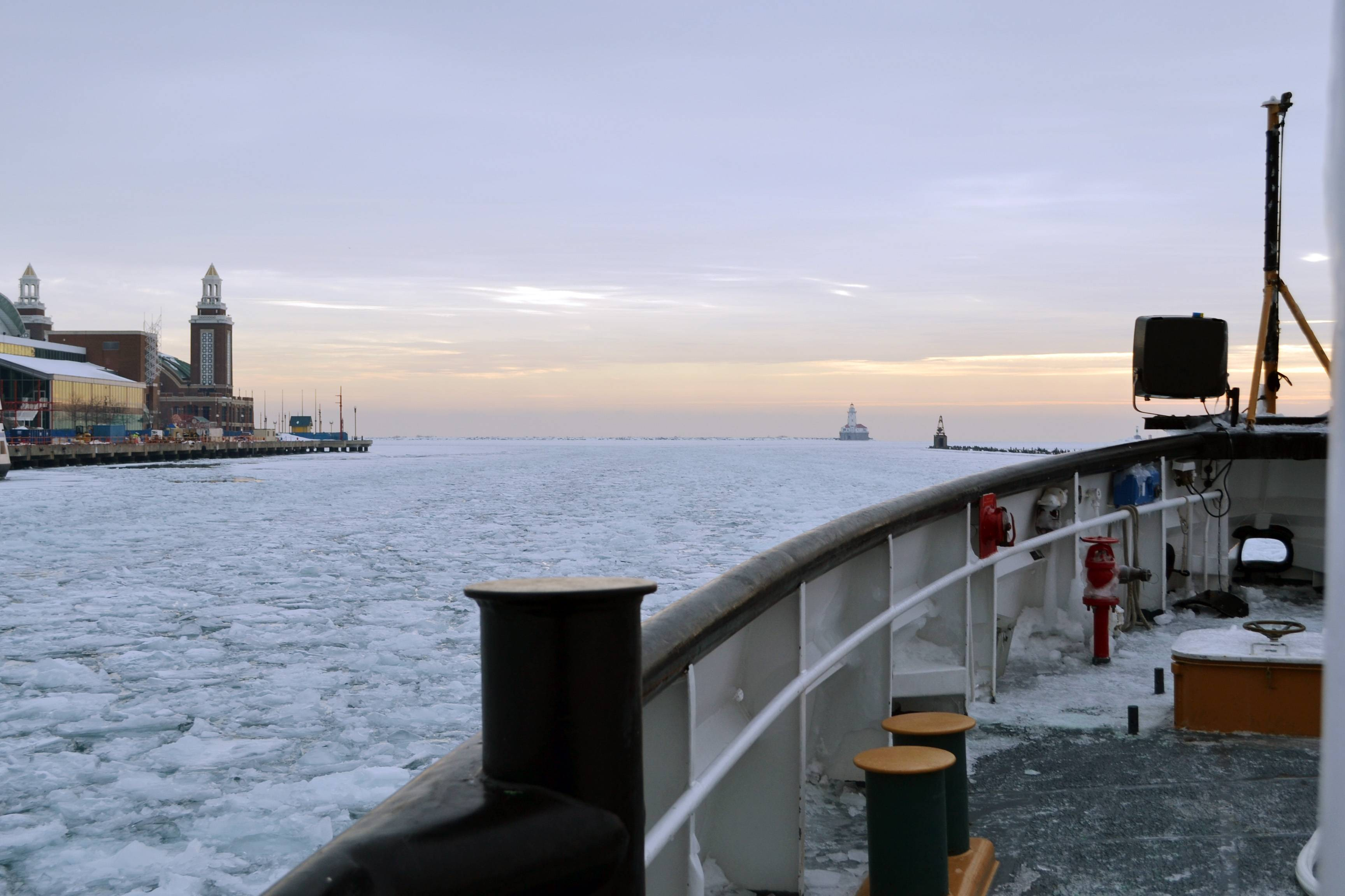 The icebreaker Biscayne Bay passes Chicago's Navy Pier as it plows through the ice-covered waters of Lake Michigan on its way to Indiana on Wednesday.