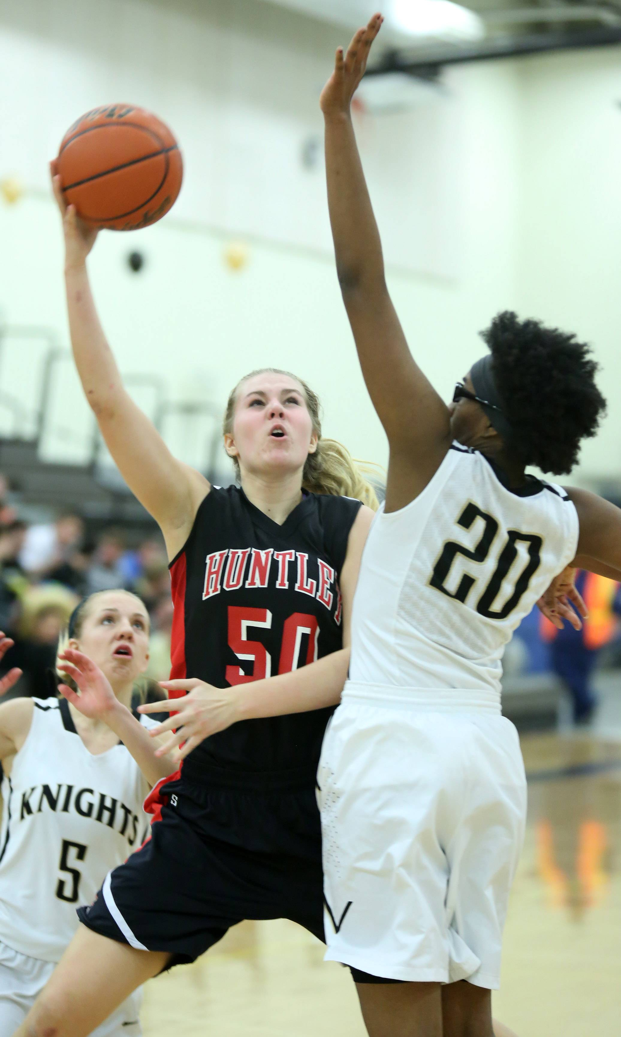 Huntley forward Ali Andrews shoots around Grayslake North defender Brittany Thiebeaux at Grayslake North on Friday.
