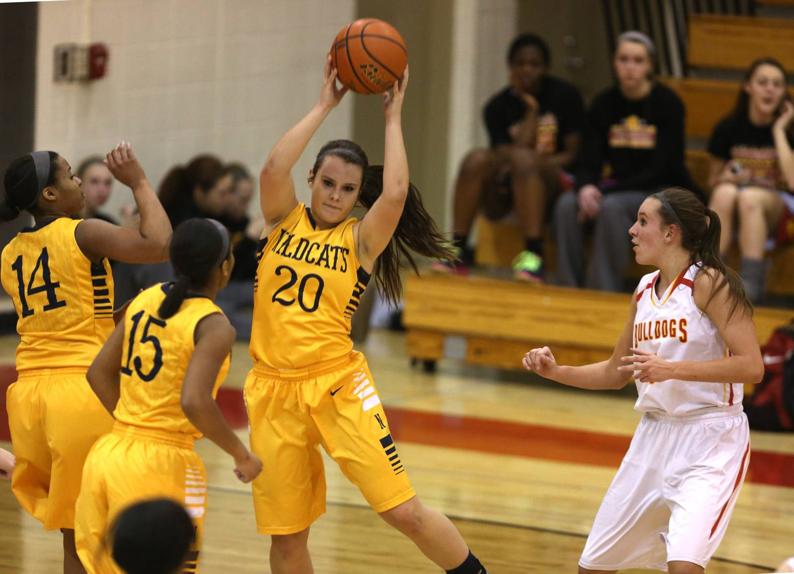 Neuqua Valley's Niki Lazar grabs a rebound against Batavia.