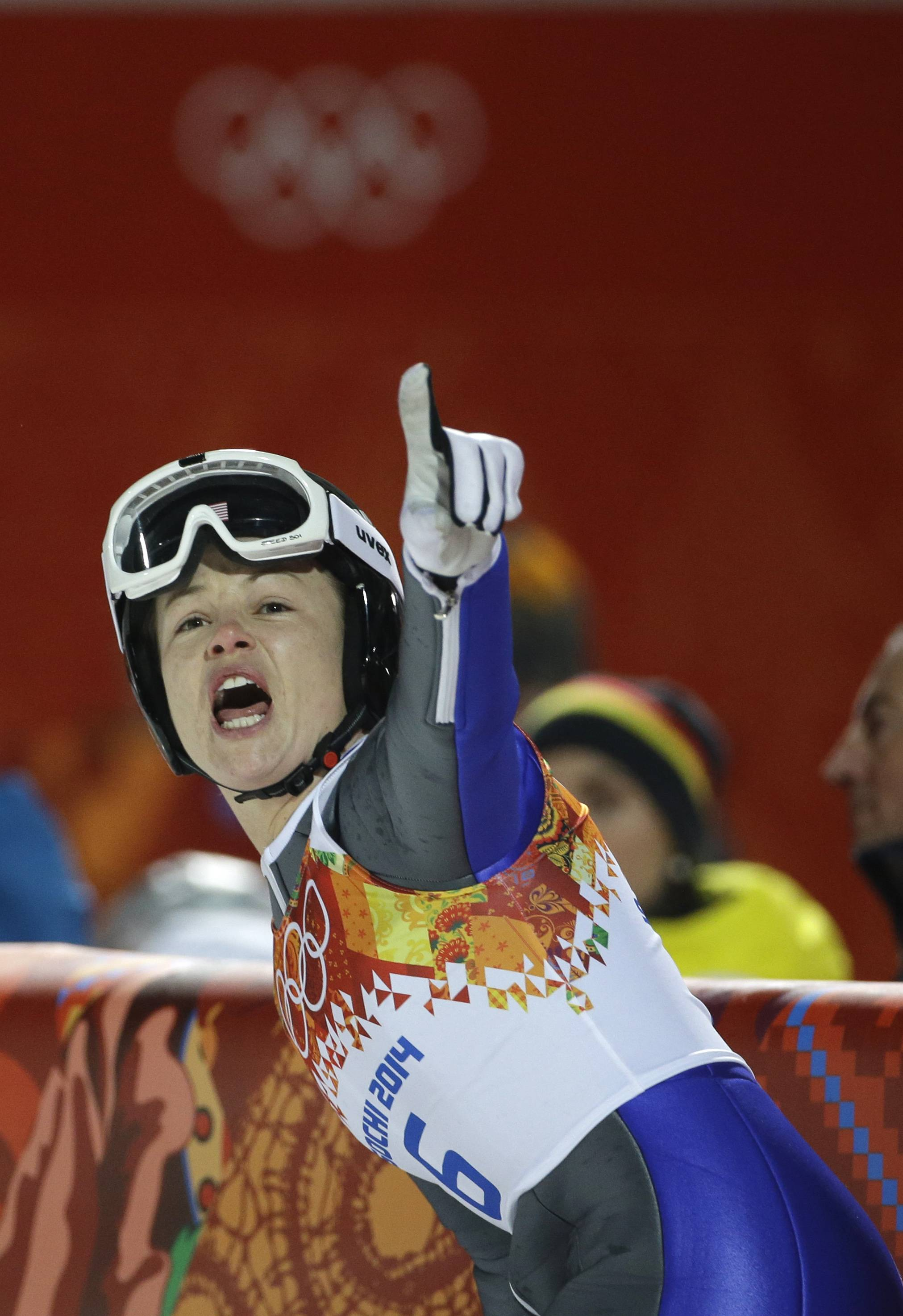 United States' Lindsey Van points to spectators after her first attempt during the women's normal hill ski jumping final at the 2014 Winter Olympics, Tuesday, Feb. 11, 2014, in Krasnaya Polyana, Russia. (AP Photo/Gregorio Borgia)