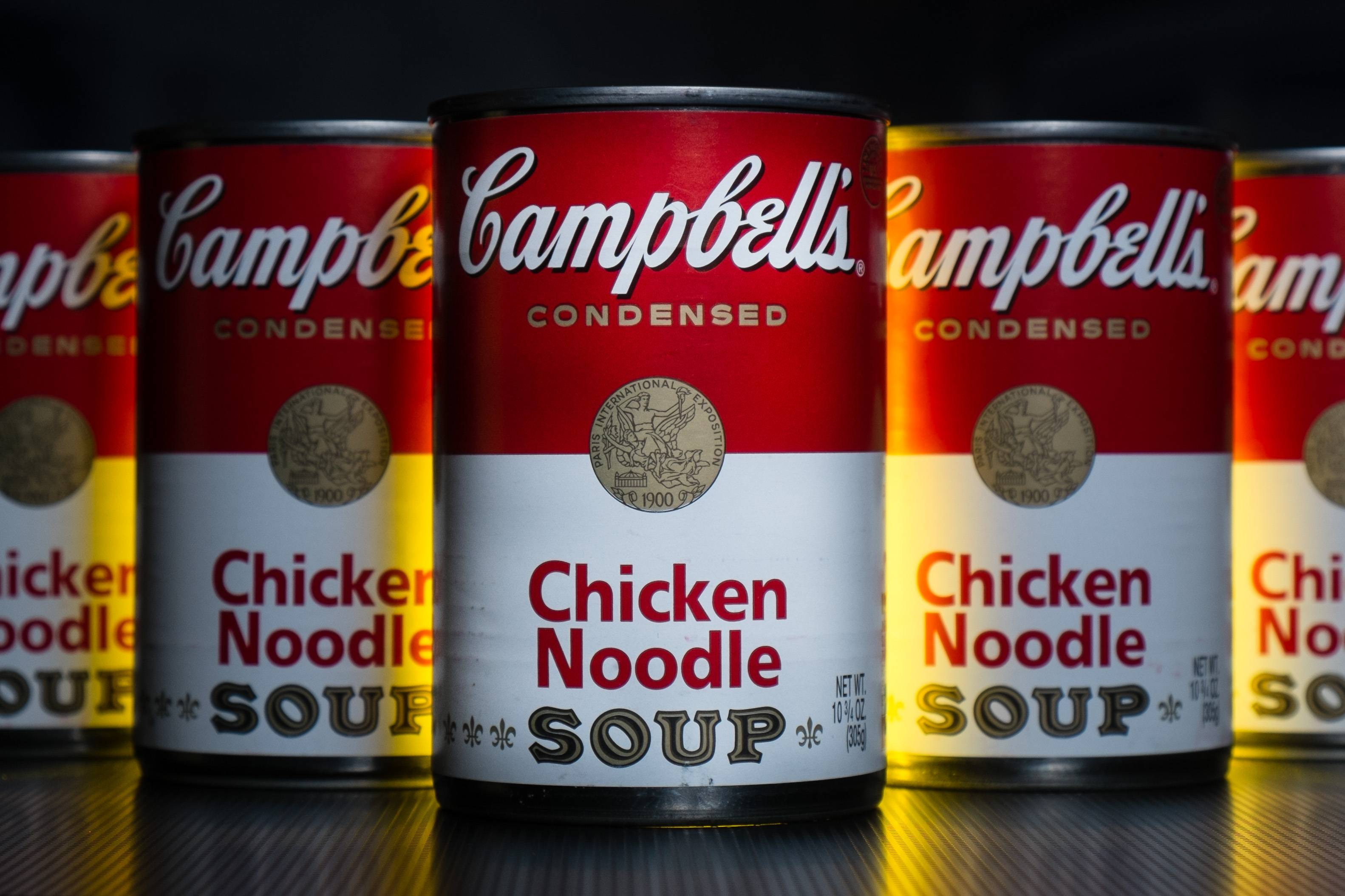 In this Wednesday, Jan. 8, 2014, photo, cans of Campbell's soup are photographed in Washington.  Campbell Soup reported a higher quarterly profit on Friday, Feb. 14, 2014, as U.S. soup sales rose 5 percent.