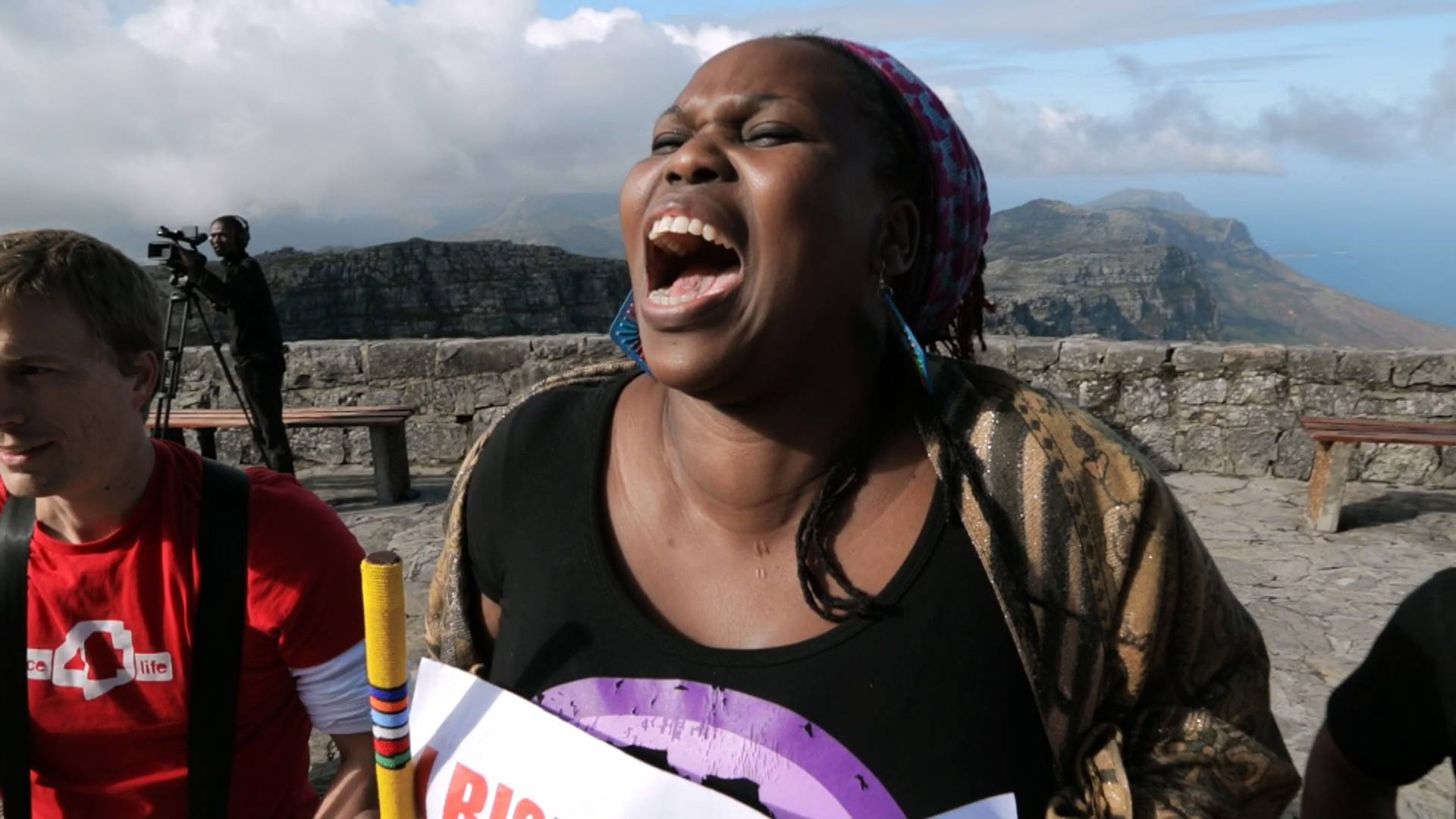"A woman rises on Table Mountain in Capetown, South Africa, in ""One Billion Rising."""