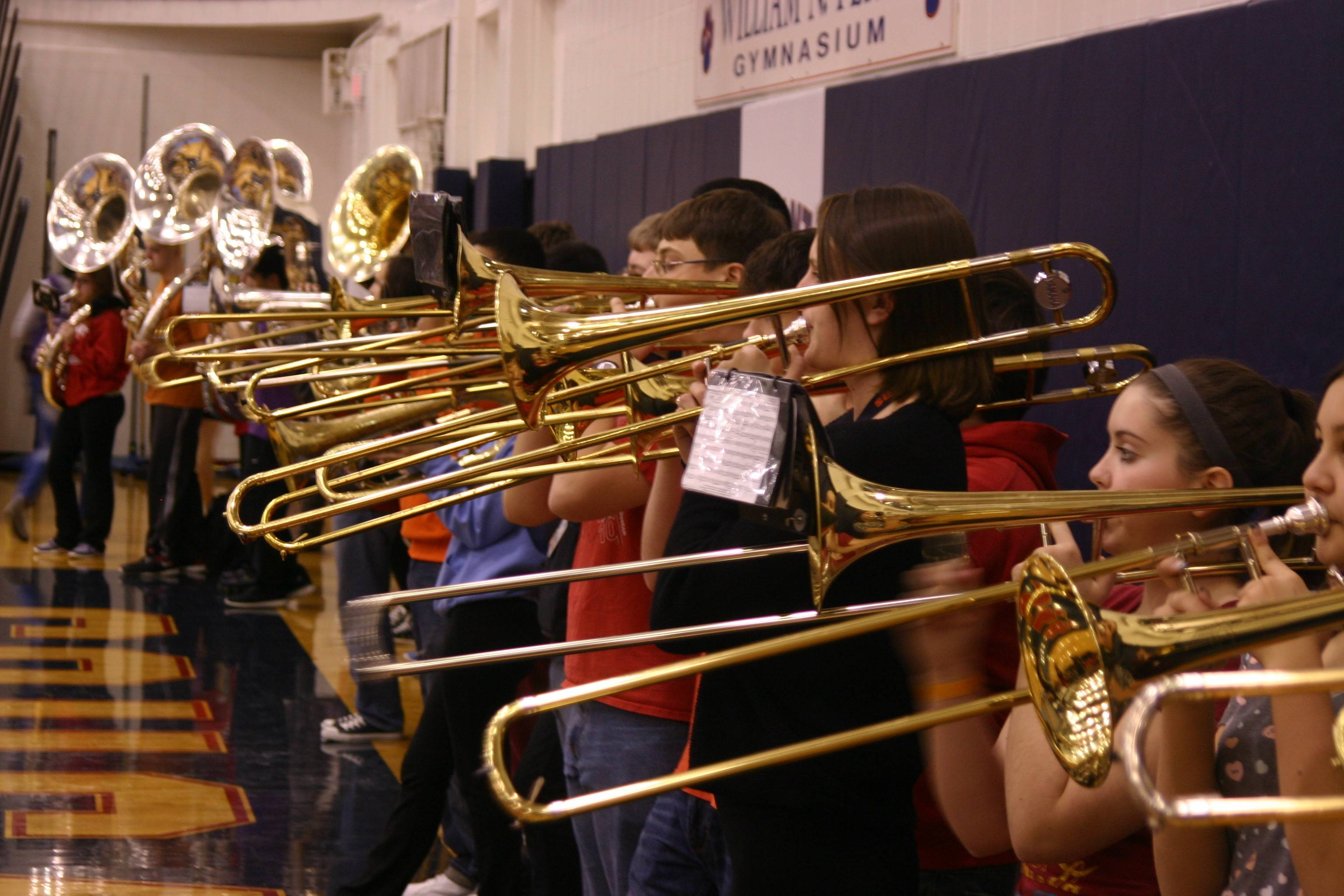 The Conant High School band plays as part of Friday's pep rally celebrating the coed cheerleading team's state championship.