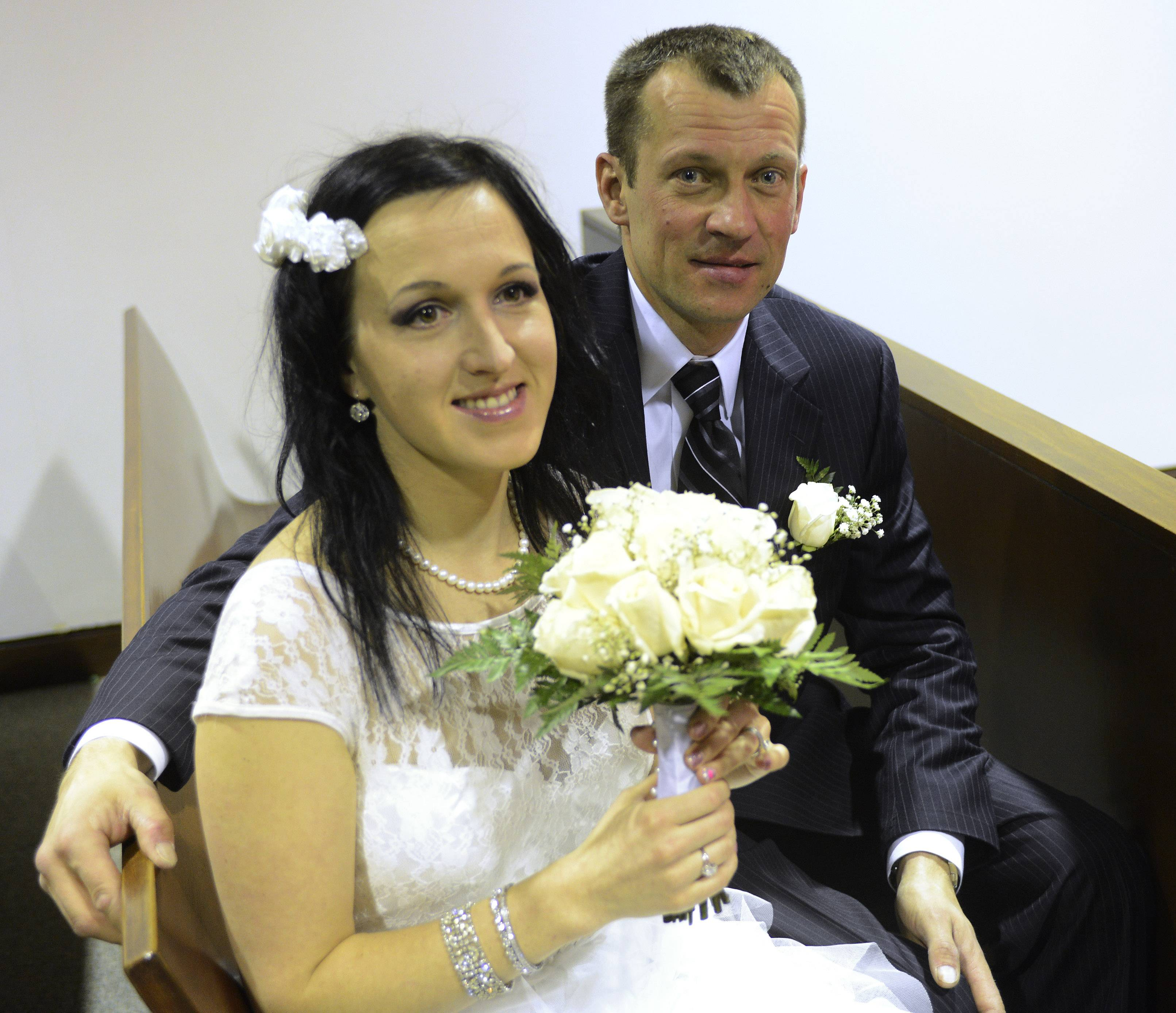 Agne and Audrius Cepronas of Barrington wait to be married.