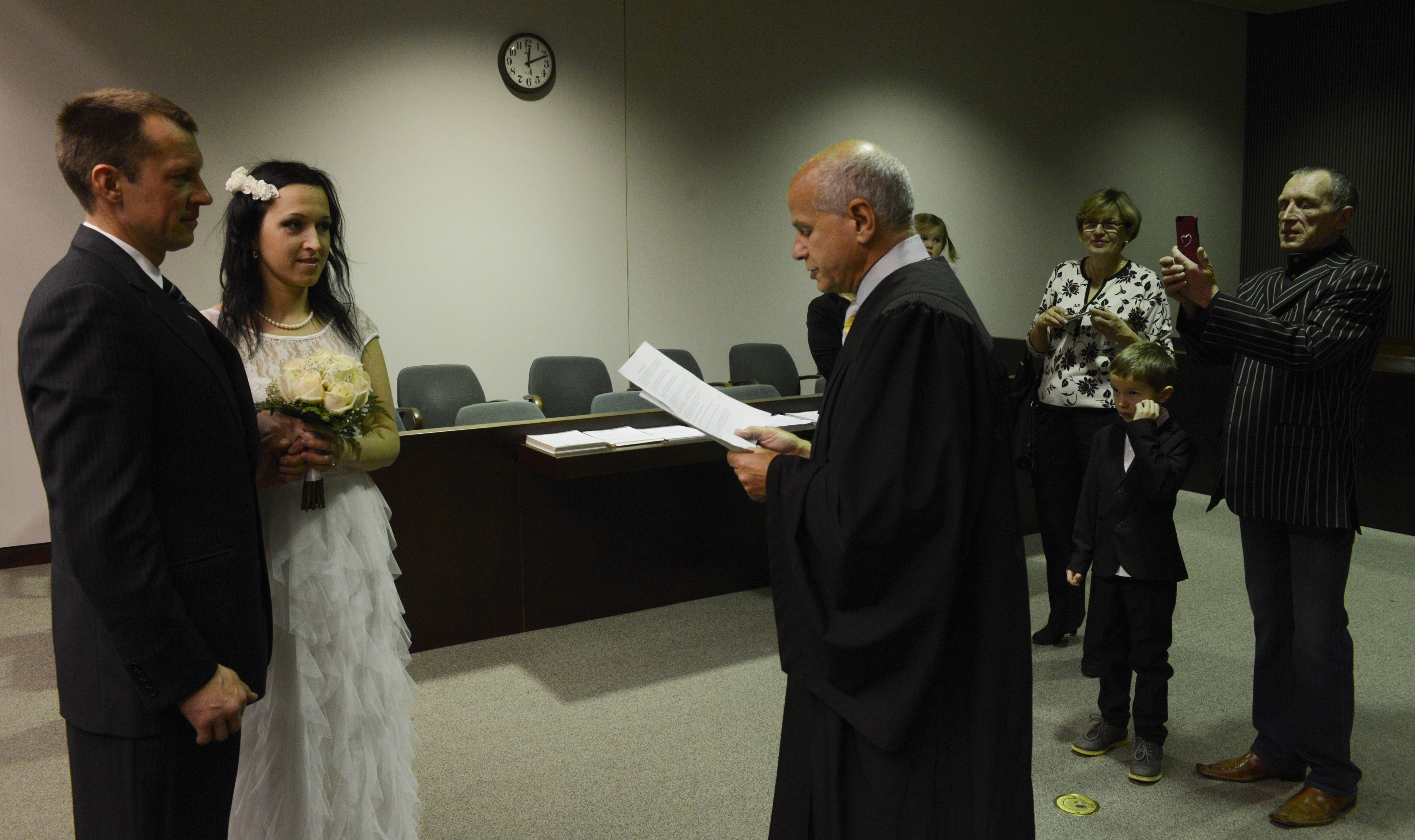 Audrius and Agne Cepronas of Barrington are married by Judge Martin Agran at the Rolling Meadows Courthouse.