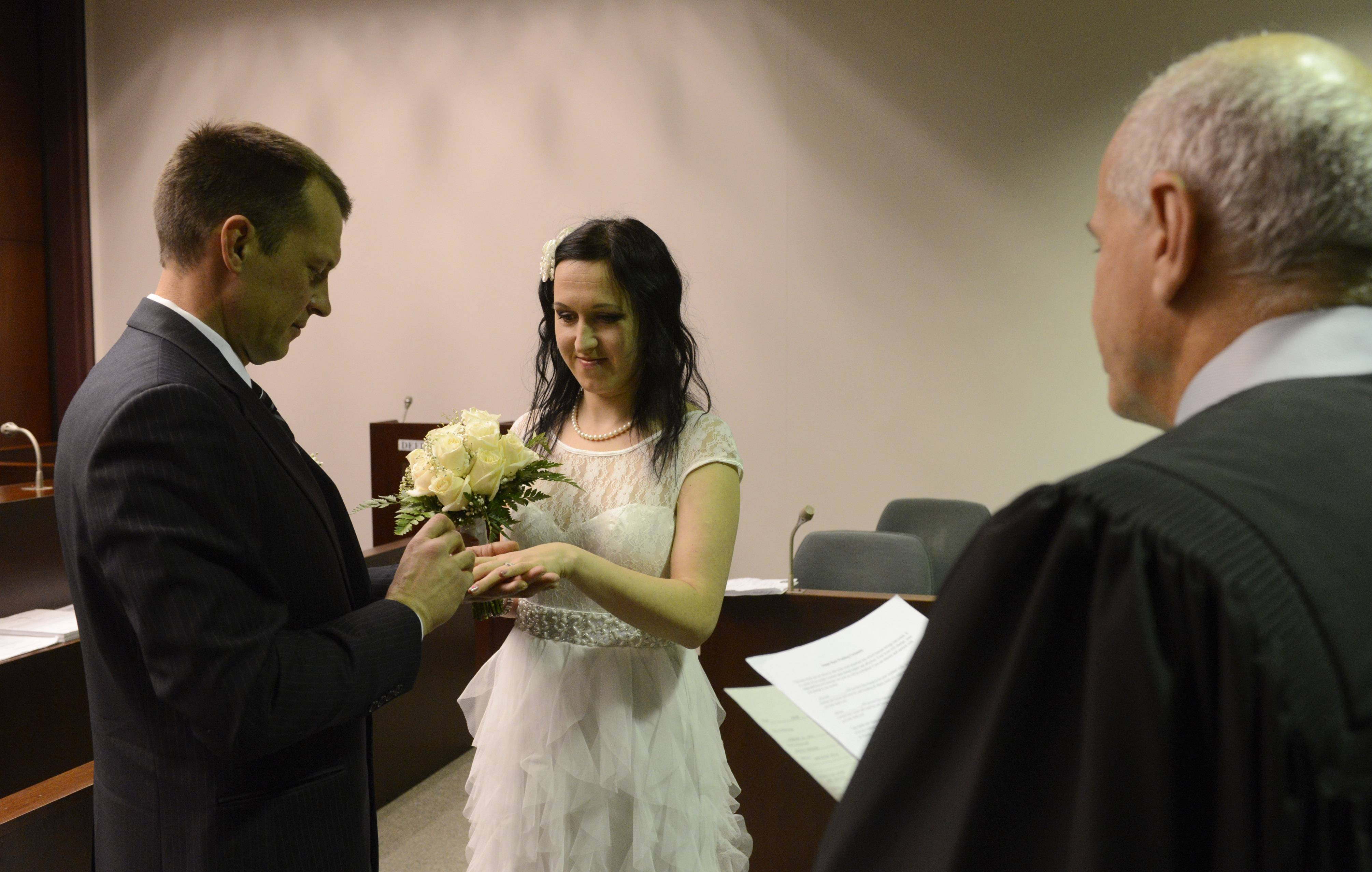 Audrius and Agne Cepronas of Barrington are married by Judge Martin Agran.