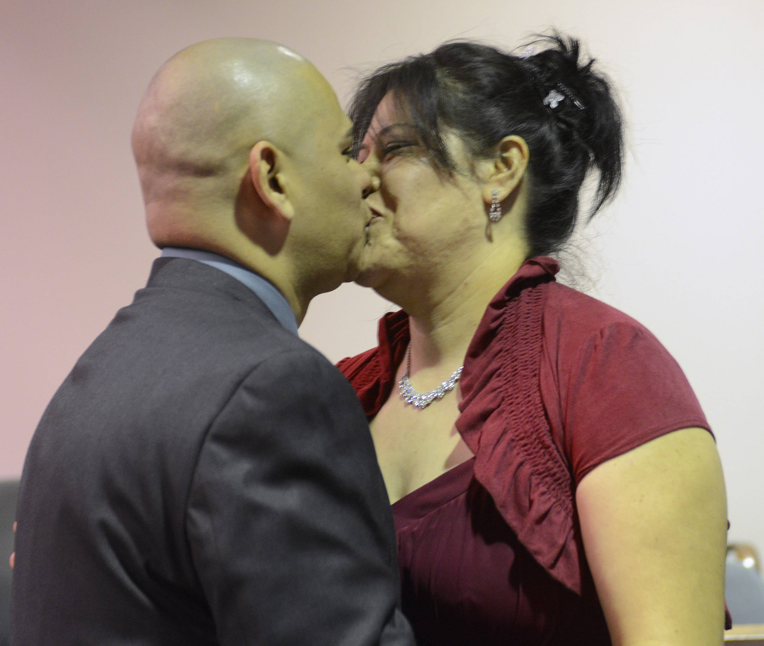 "Carlos Negrete and Carolina Pichardo of Mount Prospect reach the ""you may kiss the bride"" part of the ceremony."