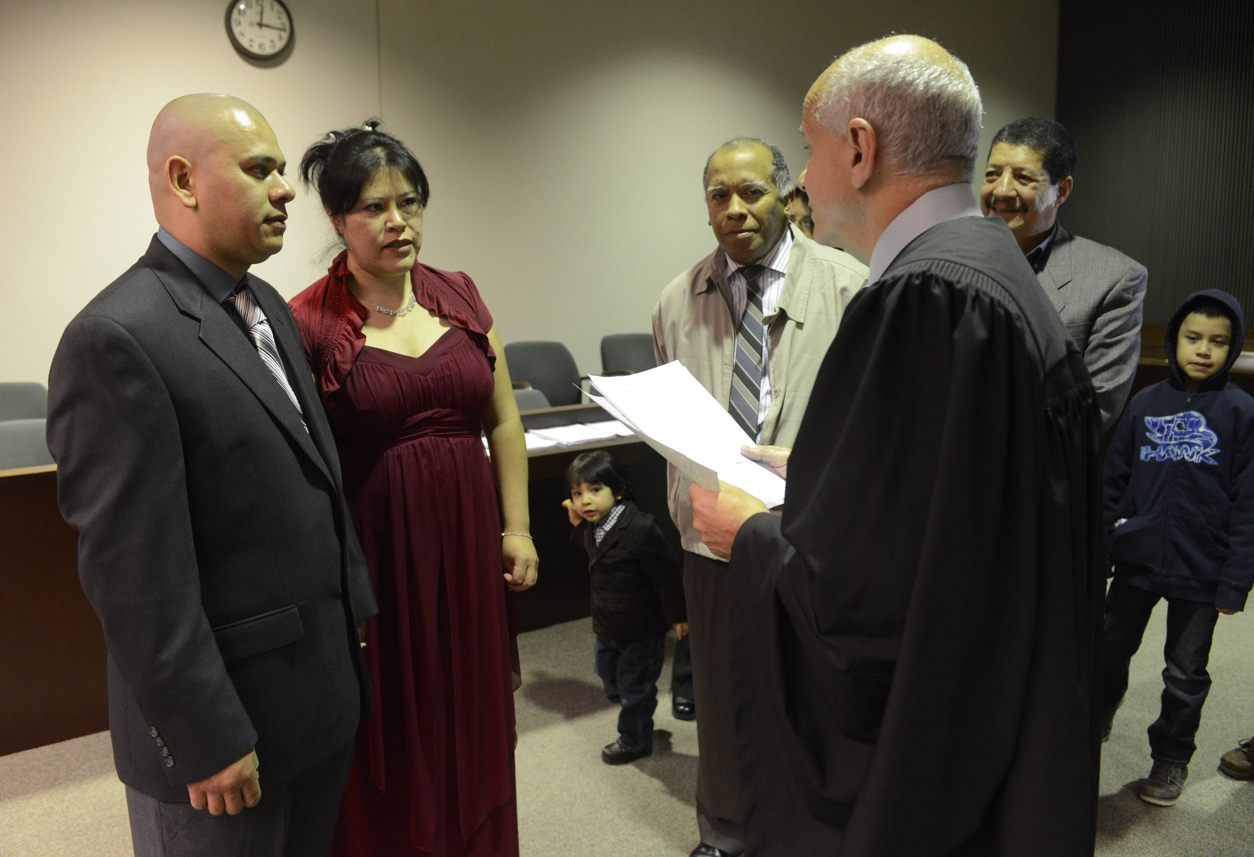 Carlos Negrete and Carolina Pichardo of Mount Prospect are one of three couples married on Valentine's Day by Judge Martin Agran.