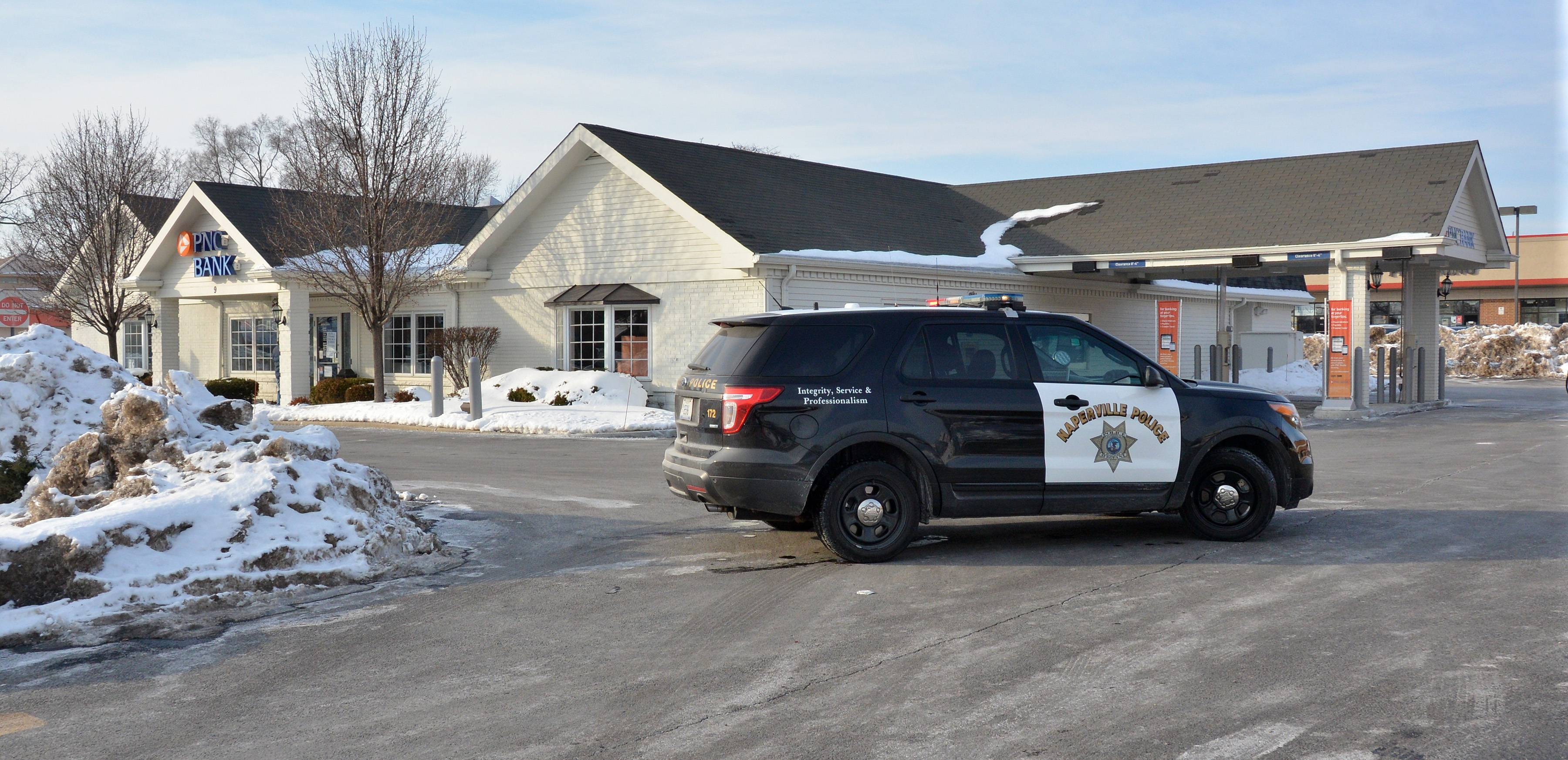 Naperville police investigate an armed robbery Friday at the PNC Bank at Washington Street and Ogden Avenue.