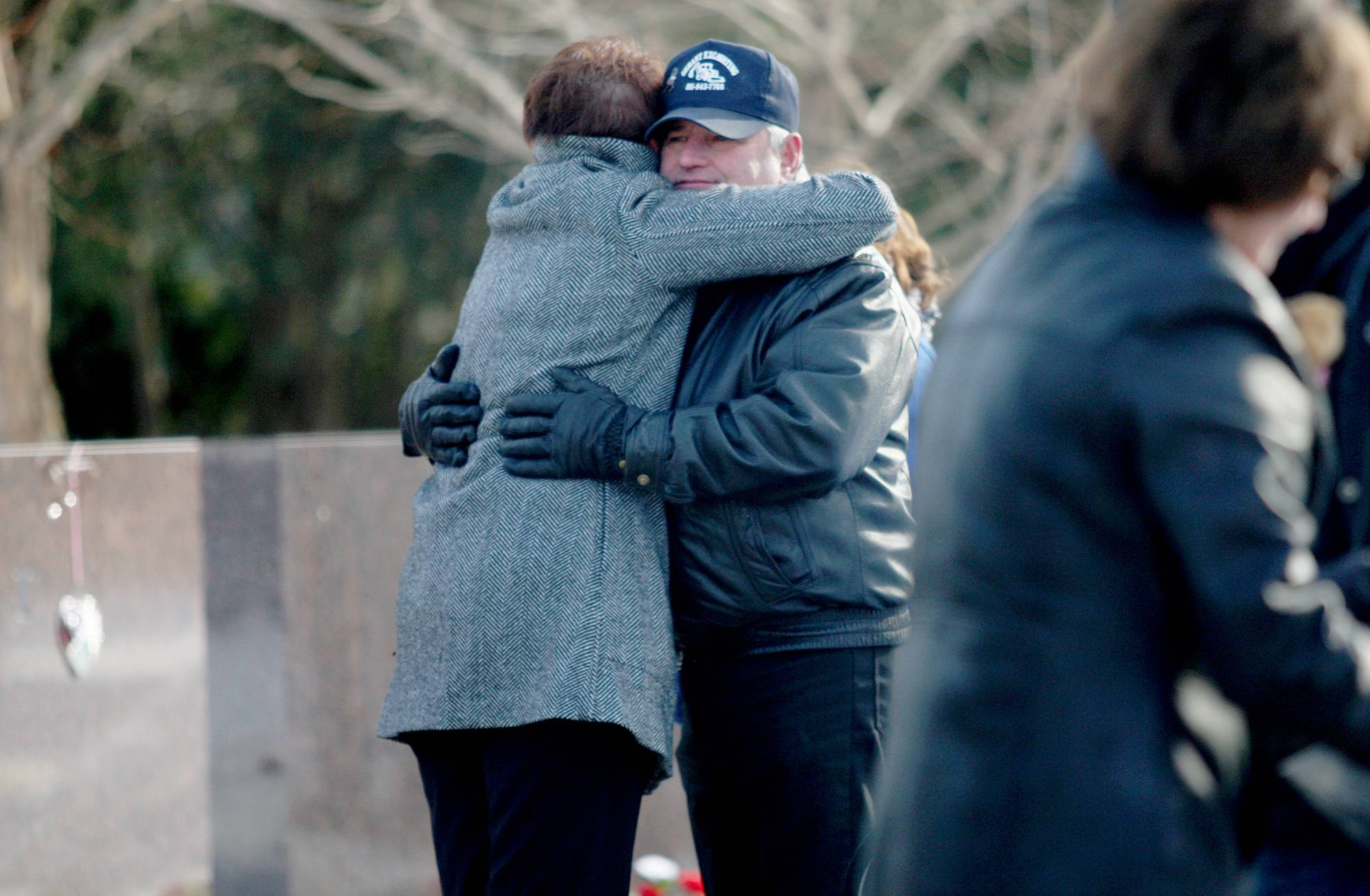 Larry Gehant, uncle of victim Julianna Gehant, hugs Northern Illinoins Associate Vice President of Student Affairs Kelly Wesener-Michael on Fridy during a moment of reflection on the sixth anniversary of the campus shooting.