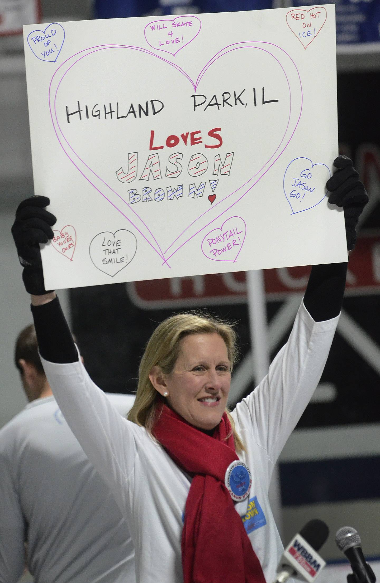 Highland Park Mayor Nancy Rotering cheers with the crowd Friday during a viewing party at the Centennial Ice Arena for U.S. Olympic skater Jason Brown from Highland Park.
