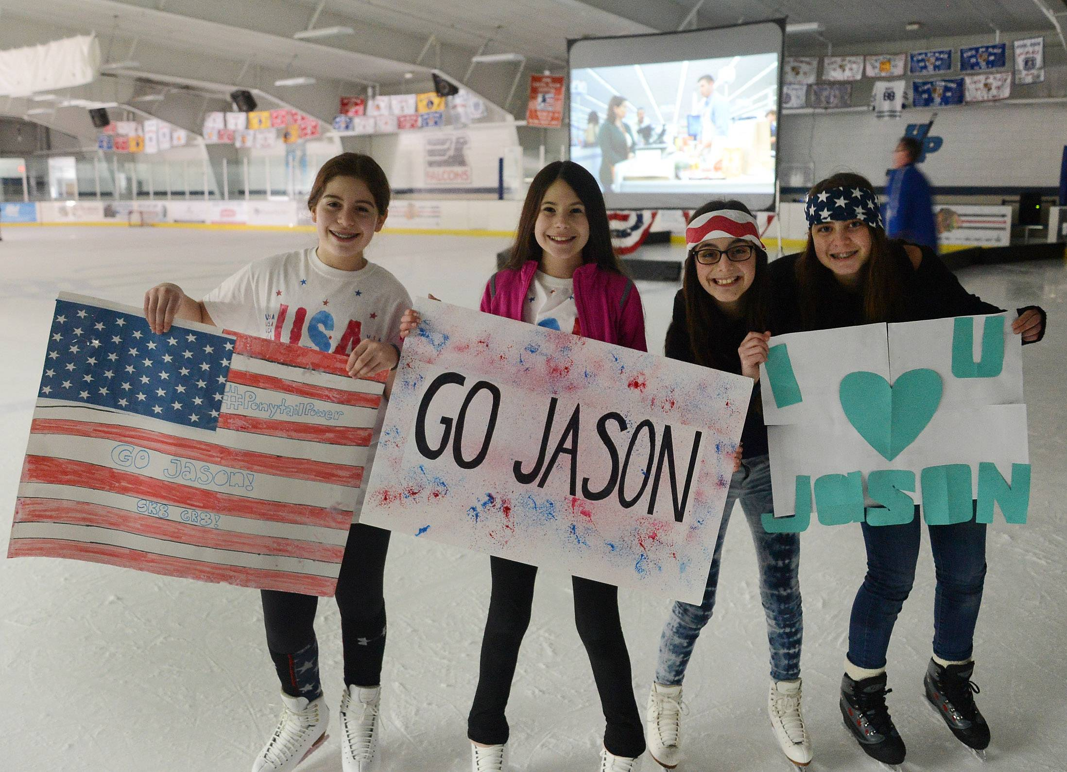 Fans of Jason Brown from left, Holly Gussis, Kylie Gimbel, Ina Hoffman and Hannah Frazer, cheer during the viewing party at the Centennial Ice Arena Friday for U.S. Olympic skater Jason Brown from Highland Park.