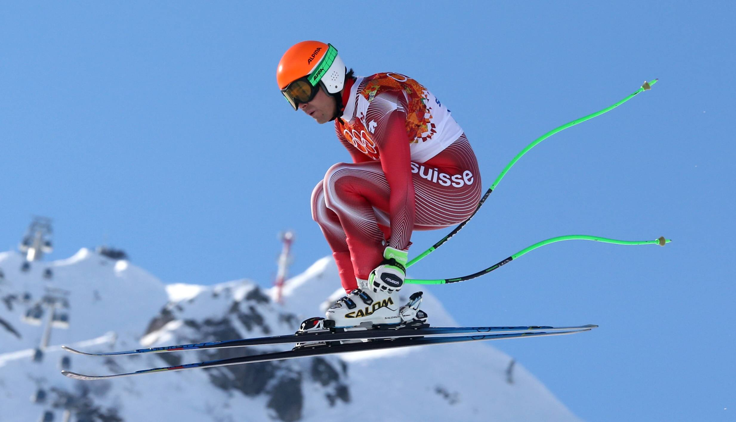 Switzerland's Sandro Viletta jumps during the downhill portion of the men's supercombined at the Sochi 2014 Winter Olympics, Friday, Feb. 14, 2014, in Krasnaya Polyana, Russia. He won the gold medal.
