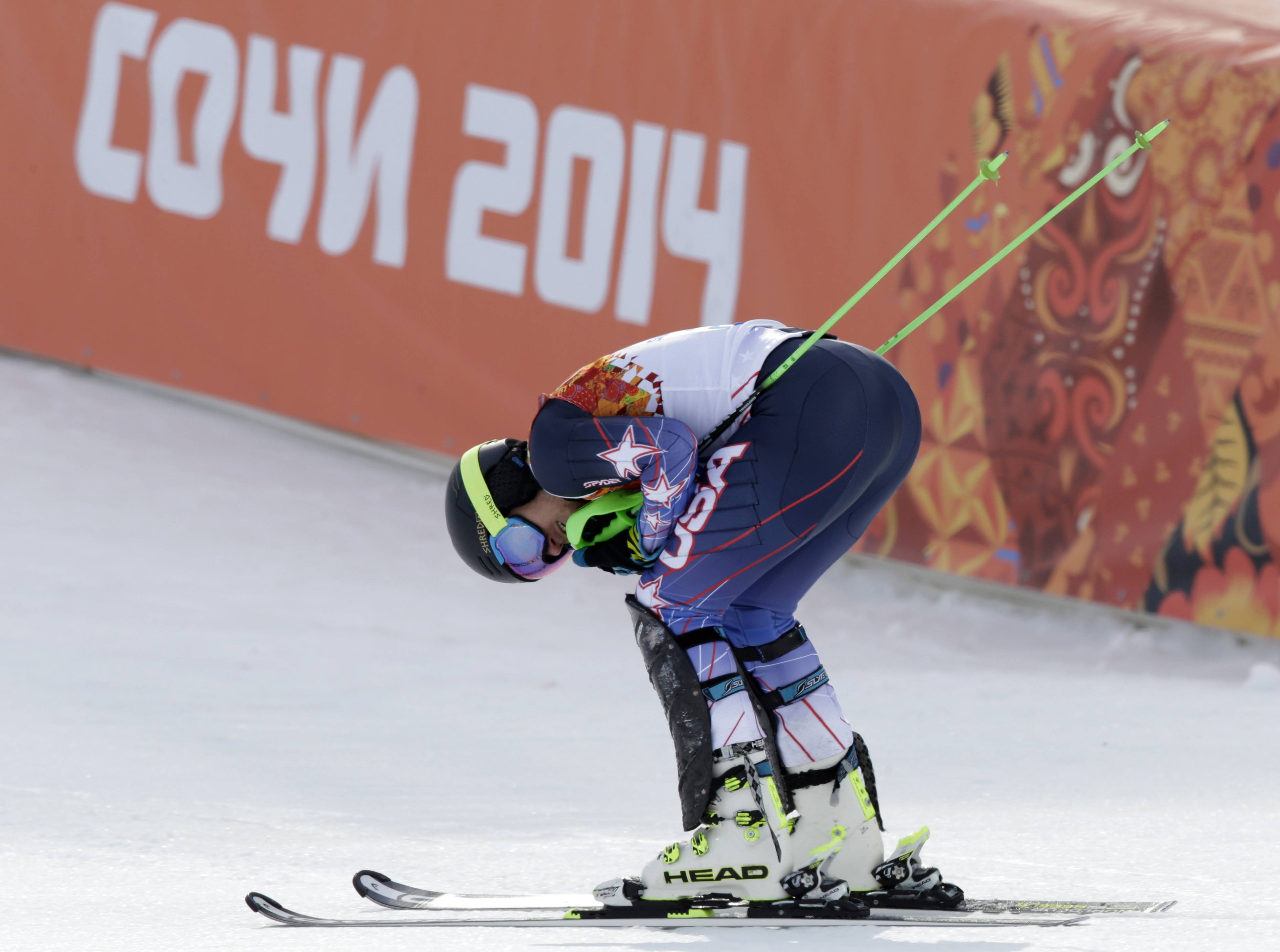 United States' Ted Ligety rests after finishing the slalom portion of the men's supercombined at the Sochi 2014 Winter Olympics, Friday, Feb. 14, 2014, in Krasnaya Polyana, Russia.