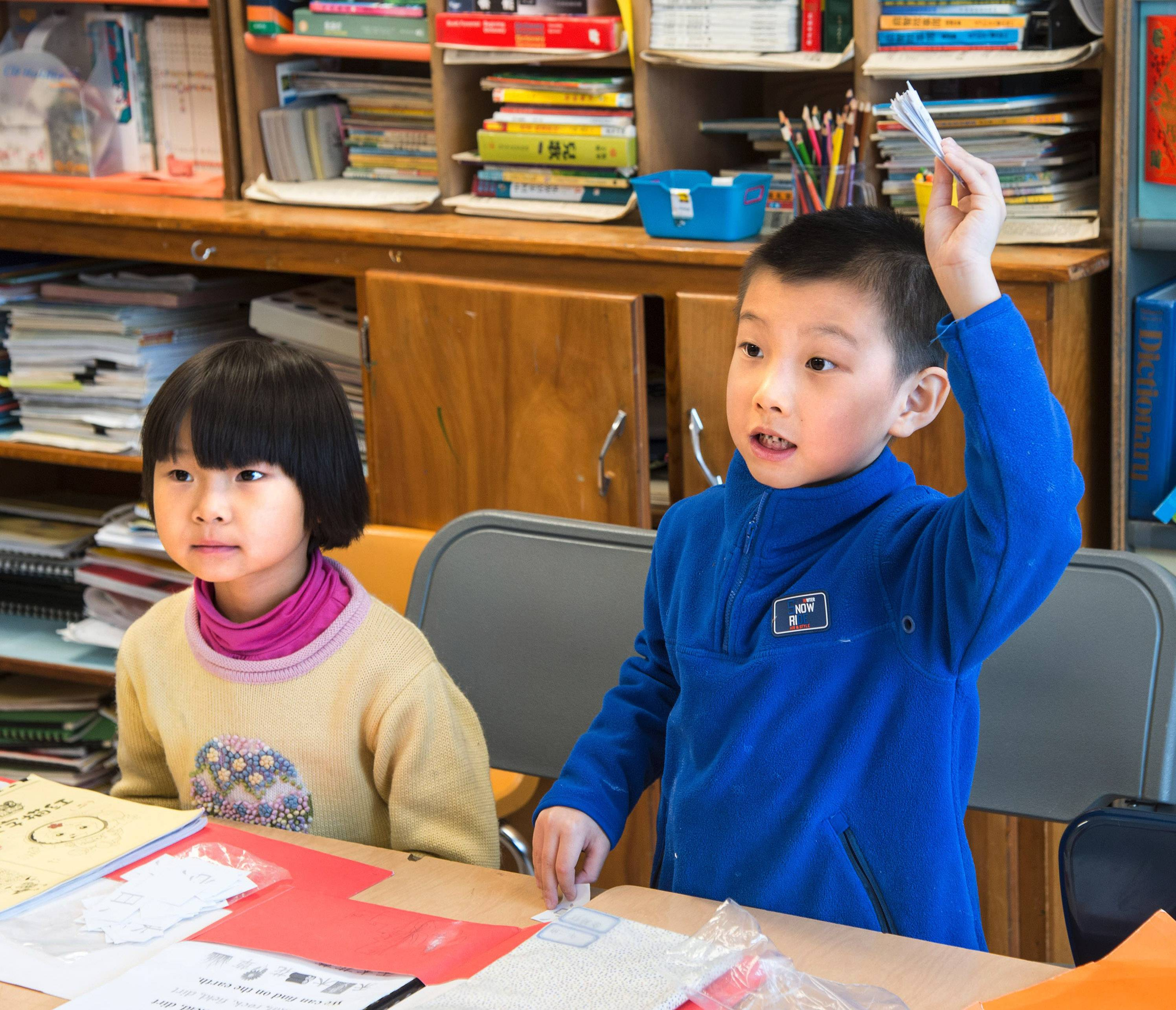 Associated PressXiyue Li, left, and Yixing Jin participate in a lesson in Lihui Zhang's Mandarin Chinese language class at Martin Luther King Elementary School in Urbana.