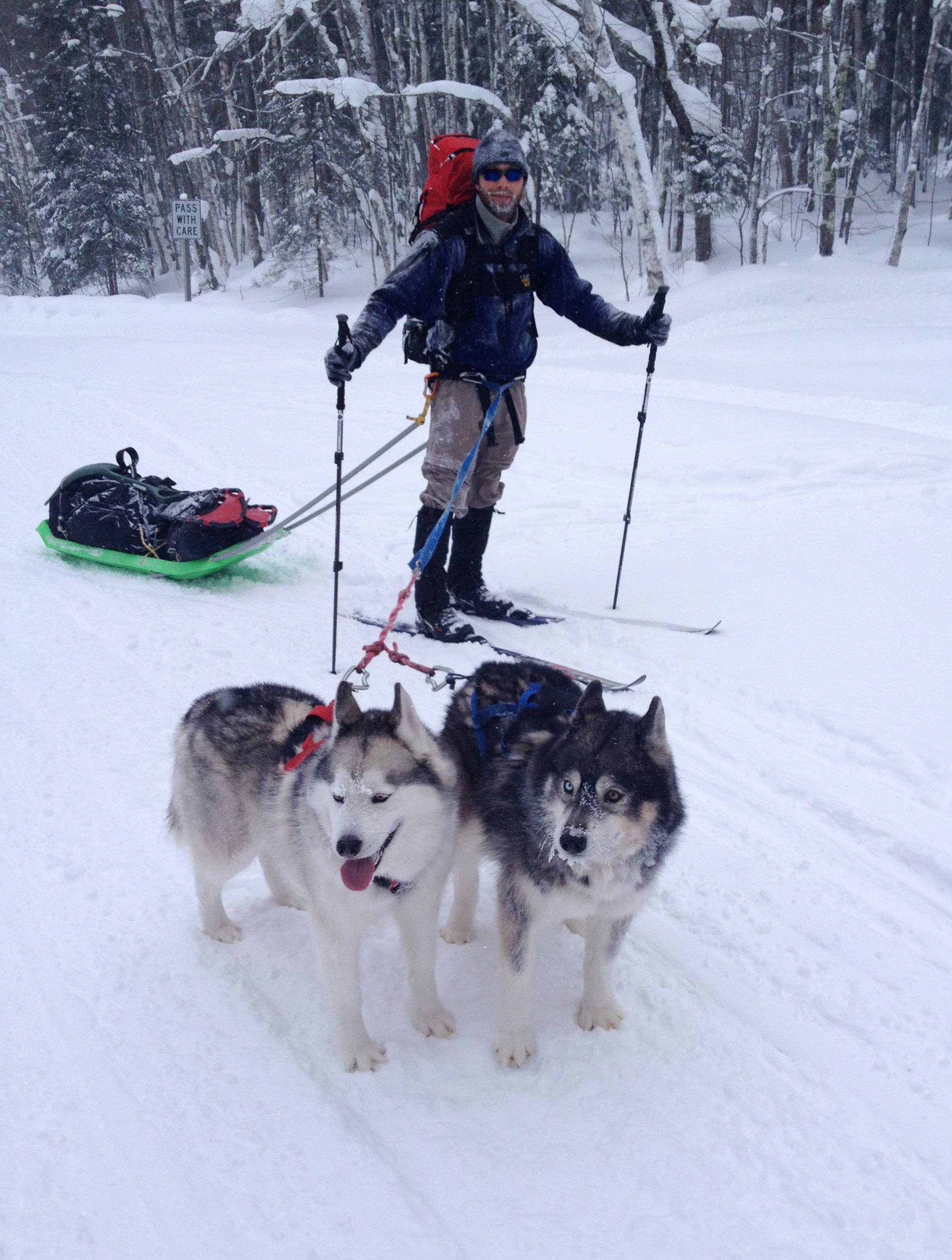 Eric Salm and his dogs, Escher, left, and Echo hike up a mountain road to go tent camping for the next three days in subzero temperatures along the Engineers Memorial Highway in Porcupine Mountains State Park in Michigan last month.