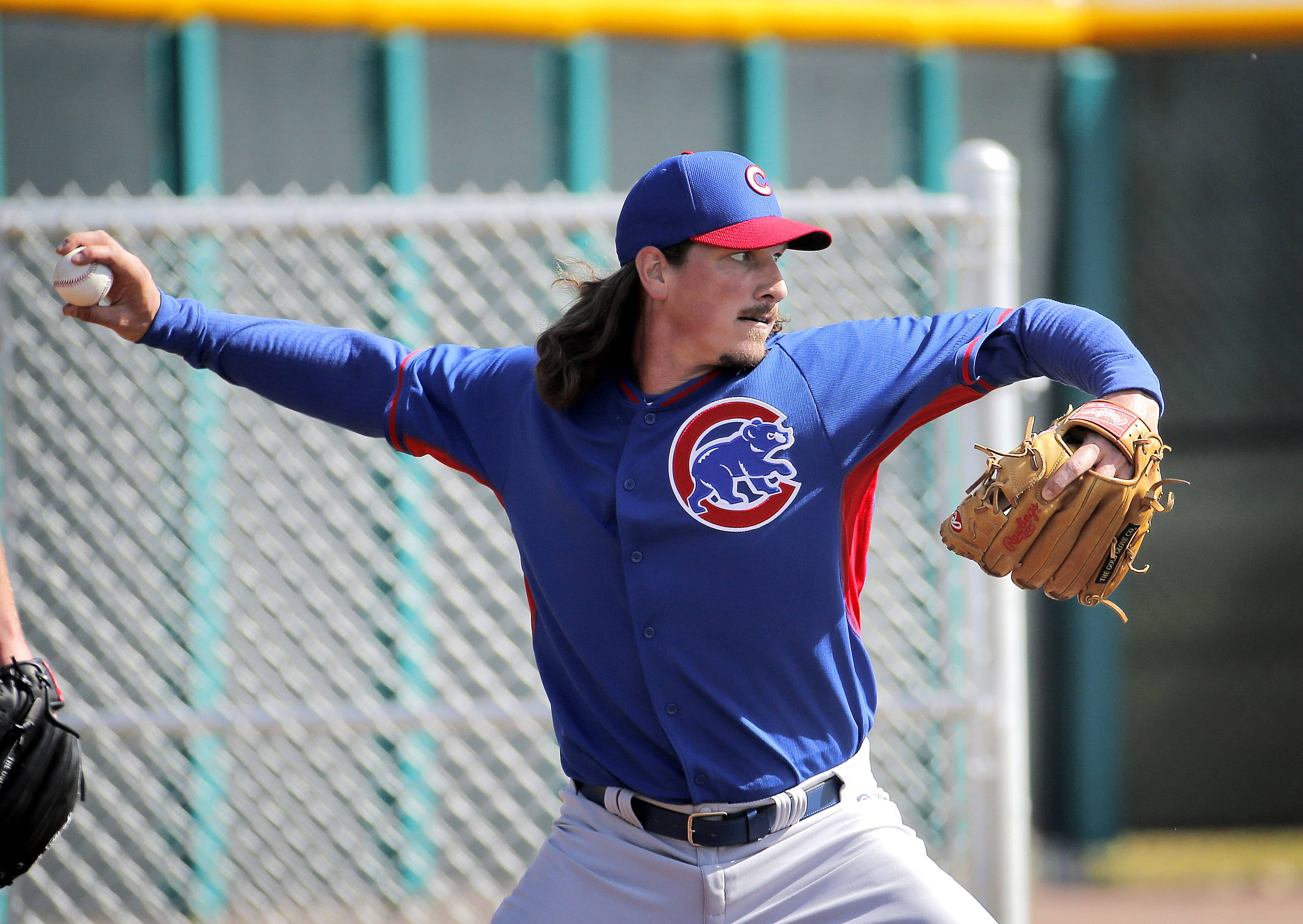 Chicago Cubs pitcher Jeff Samardzija throws during the team's first spring training baseball practice, Friday, Feb. 14, 2014, in Mesa, Ariz.