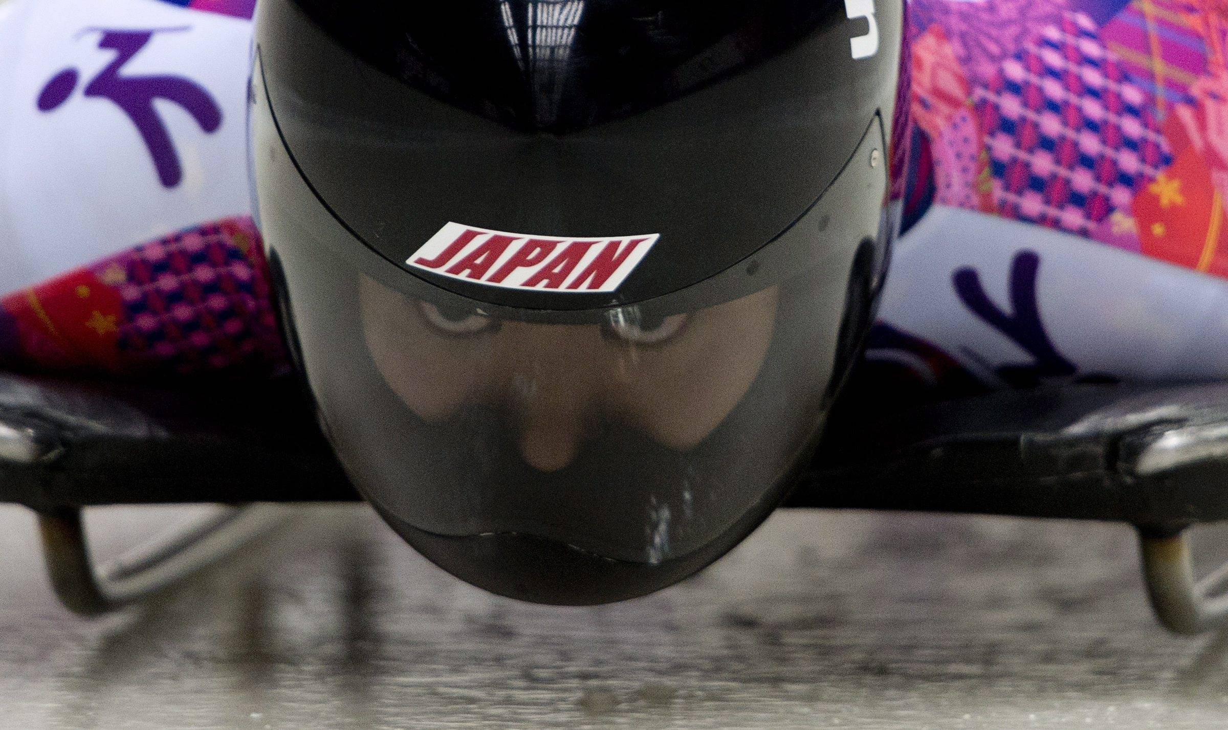 Nozomi Komuro of Japan, focuses on her run as she speeds down the track during the women's skeleton competition.