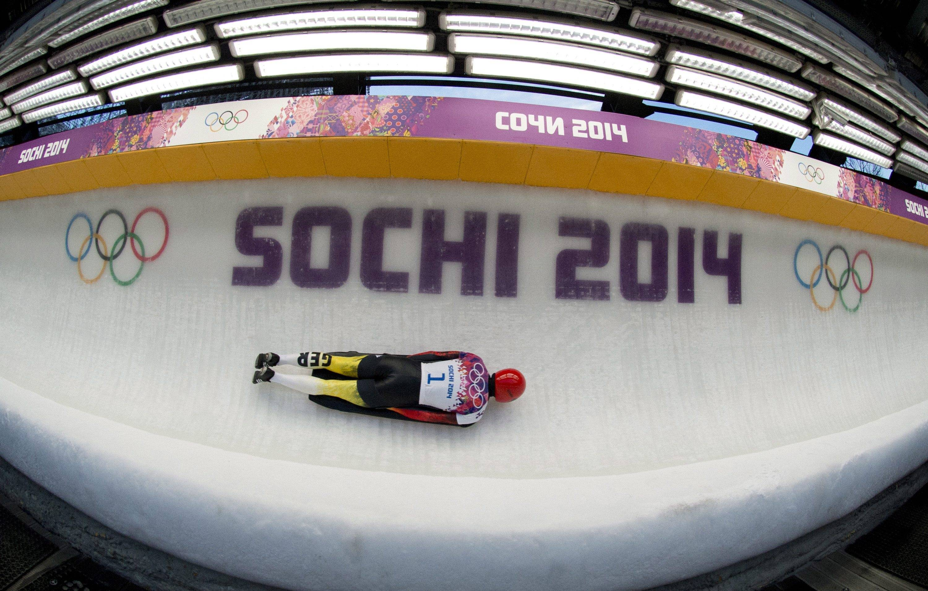 In this image taken with a fisheye lens, Frank Rommel of Germany speeds down the track during the second heat of the men's skeleton competition.